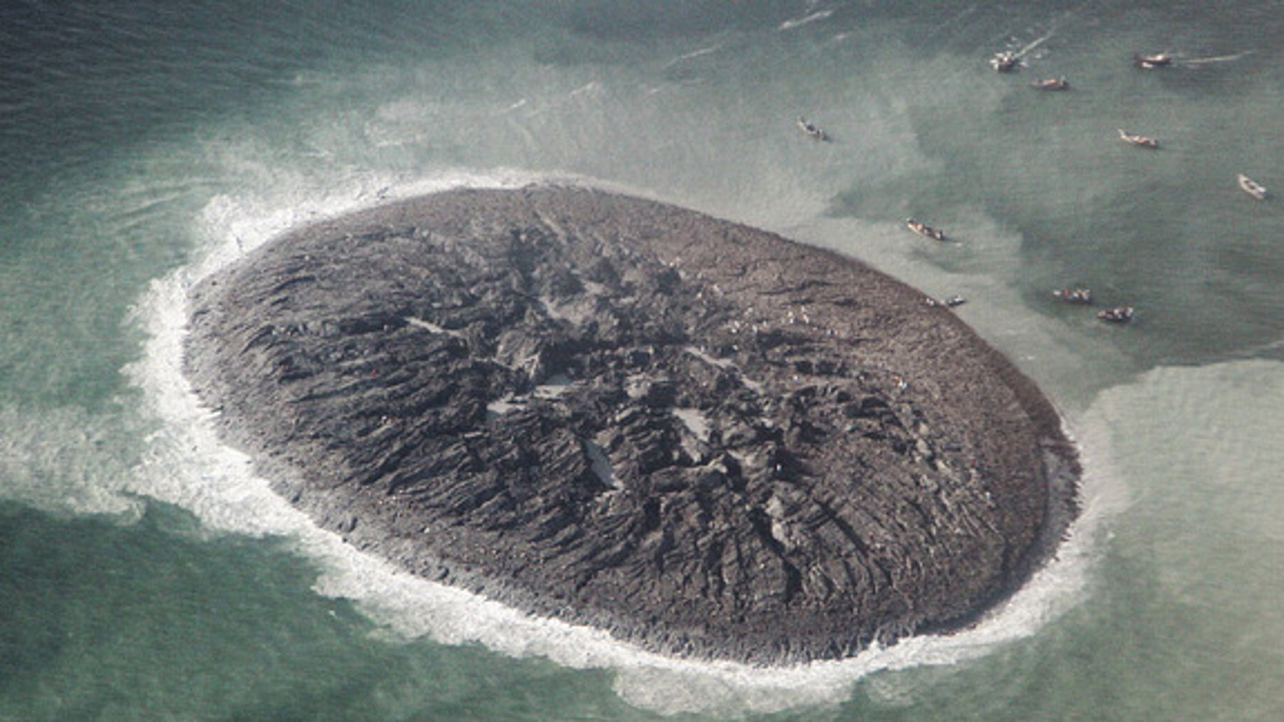 An aerial photo from Pakistan's National Institute of Oceanography suggests the new island is 60 to 70 feet (15 to 20 meters) tall.