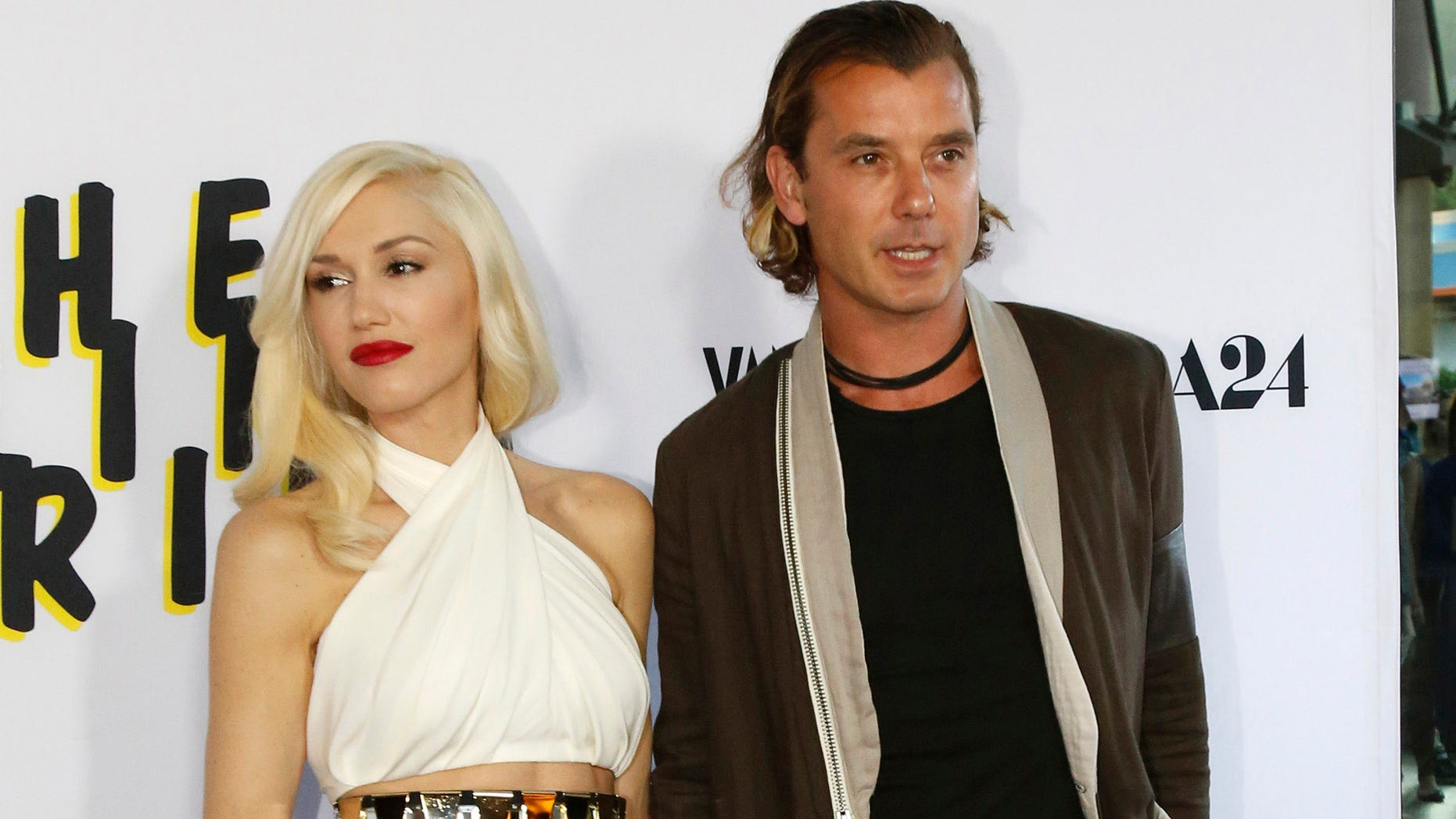 "June 4, 2013. Gavin Rossdale and his wife Gwen Stefani pose at the premiere of ""The Bling Ring"" in Los Angeles."