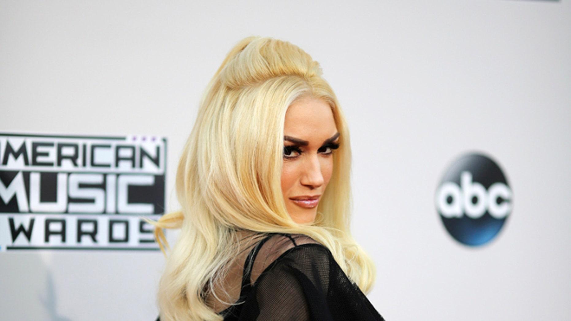 November 22, 2015. Singer Gwen Stefani arrives at the 2015 American Music Awards in Los Angeles, California.