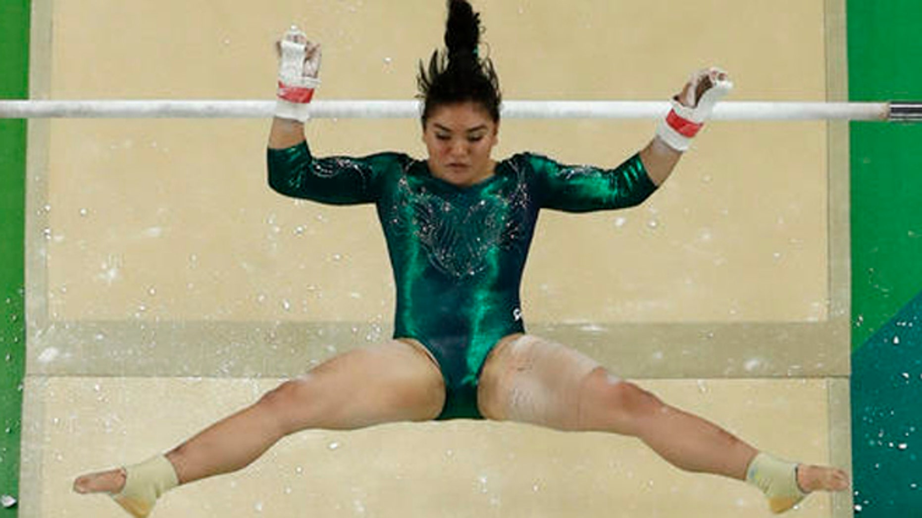 Mexico's Alexa Moreno performs on the uneven bars during the artistic gymnastics women's qualification at the 2016 Summer Olympics in Rio de Janeiro, Brazil, Sunday, Aug. 7, 2016. (AP Photo/Morry Gash)