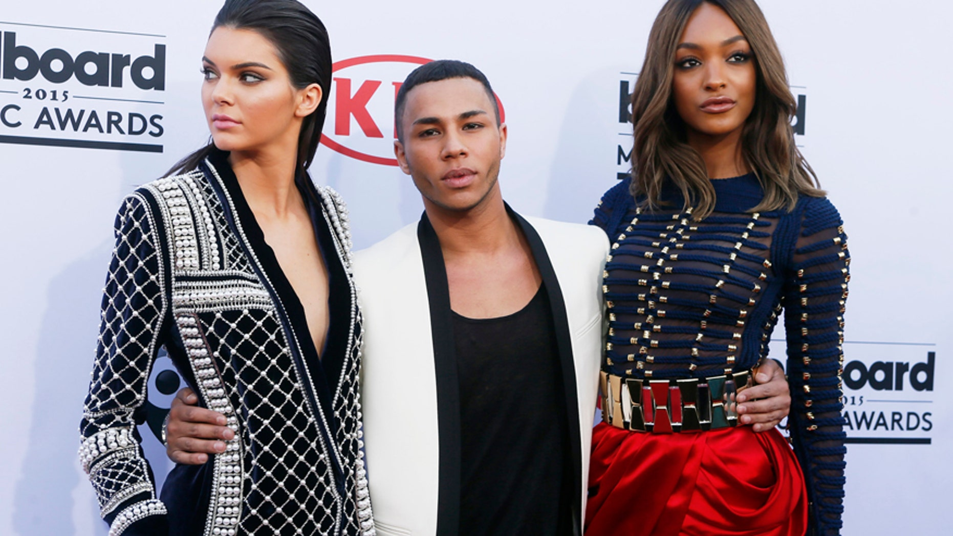 Model Kendall Jenner (L), designer Olivier Rousteing and model Jourdan Dunn arrive in H&M Balmain pieces at the 2015 Billboard Music Awards in Las Vegas, Nevada May 17, 2015.