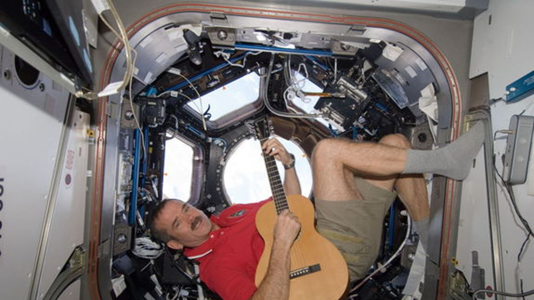 Astronaut Chris Hadfield's tweeting and guitar-strumming from orbit make him a popular draw with worldwide audiences.