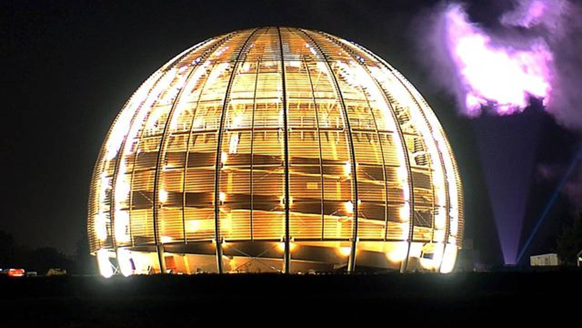 """Powerful """"skytracer"""" floodlights light up the 27-kilometre ring of the Large Hadron Collider of the CERN, European Organization for Nuclear Research, in Geneva, Switzerland."""