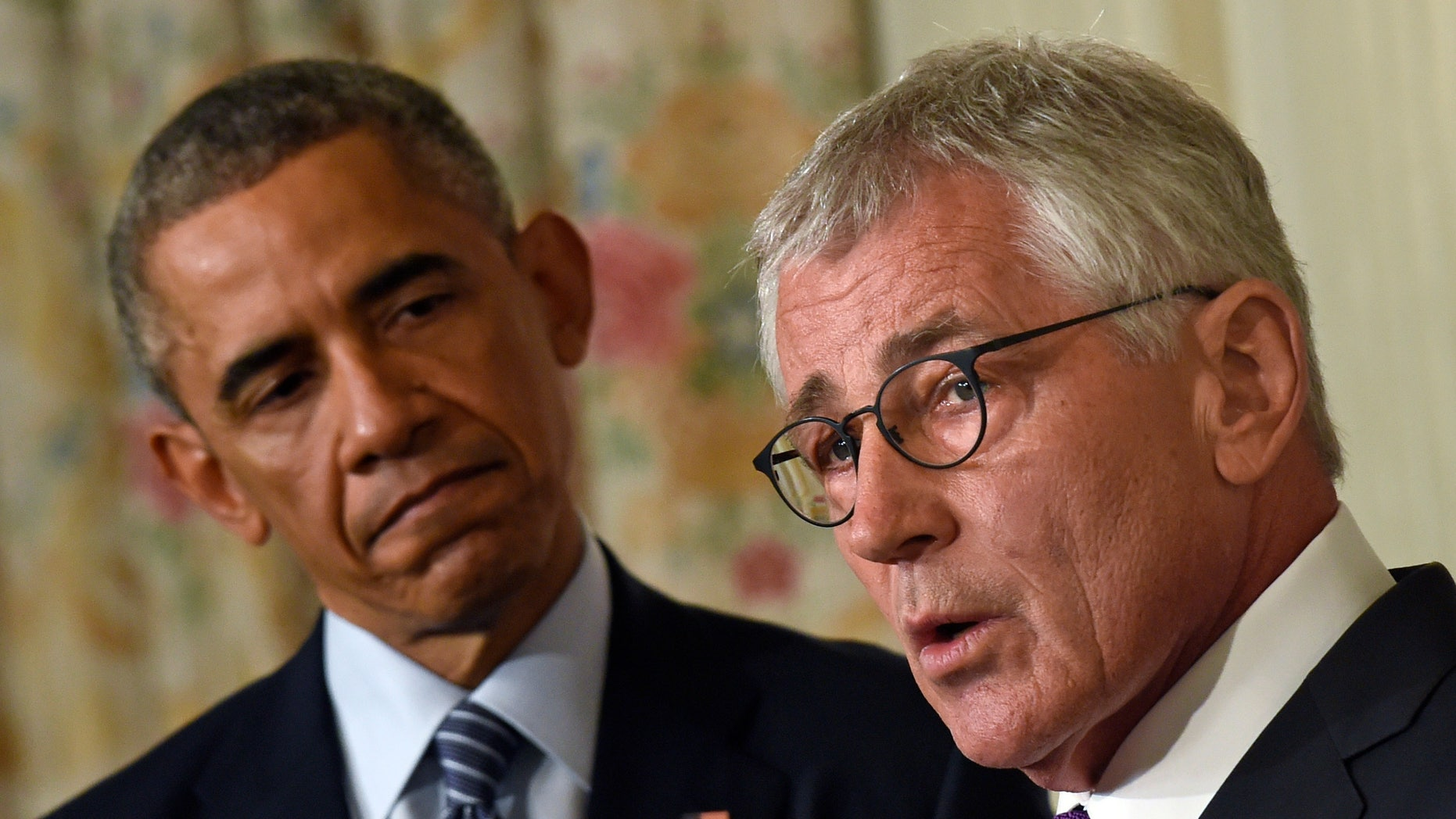 Nov. 24, 2014: President Barack Obama, left, looking to Defense Secretary Chuck Hagel, right, as he talks about his resignation during an event in the State Dining Room of the White House in Washington.