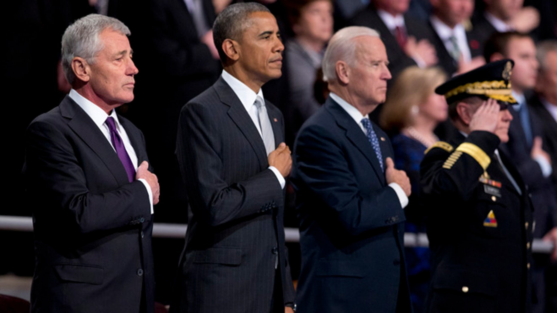 Jan. 28, 2015: From left, outgoing Defense Secretary Chuck Hagel, President Barack Obama,Vice President Joe Biden and Joint Chiefs Chairman  Gen. Martin Dempsey, put their hands over their heart as the National Anthem is played  during the farewell tribute in honor of Hagel.