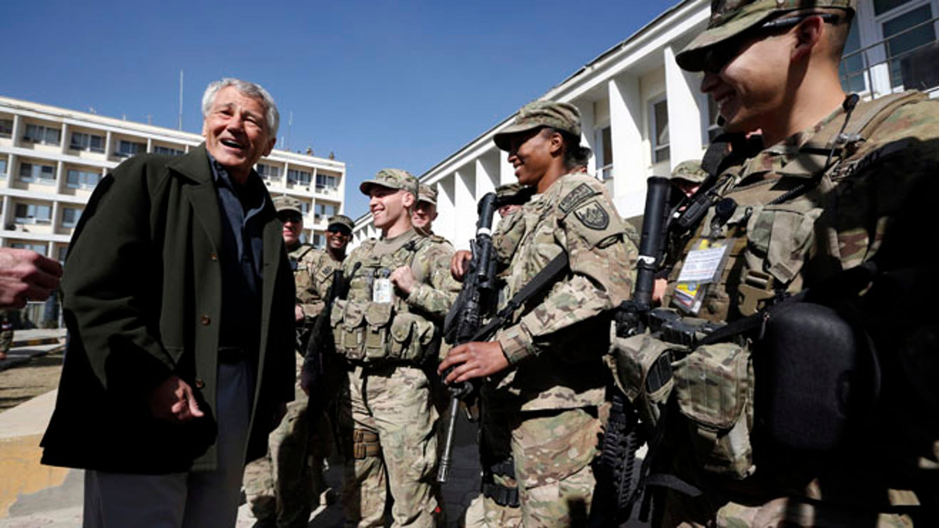 March 10, 2013: U.S. Defense Secretary Chuck Hagel, left, meets with U.S. Army troops during his visit to the Kabul Military Training Center in Kabul, Afghanistan. Hagel said he believes U.S. officials will be able to work things out with Afghan leaders who have ordered special operations forces out of Wardak province, even as commandos face a Monday deadline to leave.
