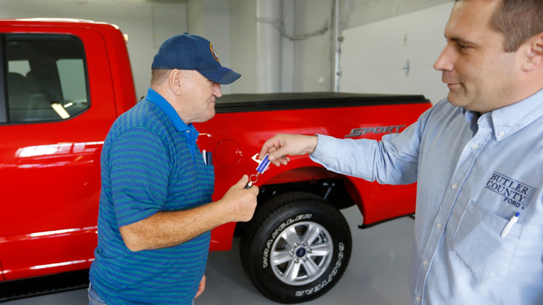 In this Thursday, Nov. 19, 2015, photo, Alton John, left, from Kittanning, Pa., gets the keys to his new 2015 Ford F-150 Supercab 4x4 pickup truck from salesman Robert Myers as he takes delivery at Butler County Ford in Butler, Pa. Haggling over a car price isnt for everyone. The angst has spawned a small but growing trend toward no-haggle alternatives found at discount club stores, some dealers and on several Internet sites. (AP Photo/Keith Srakocic)
