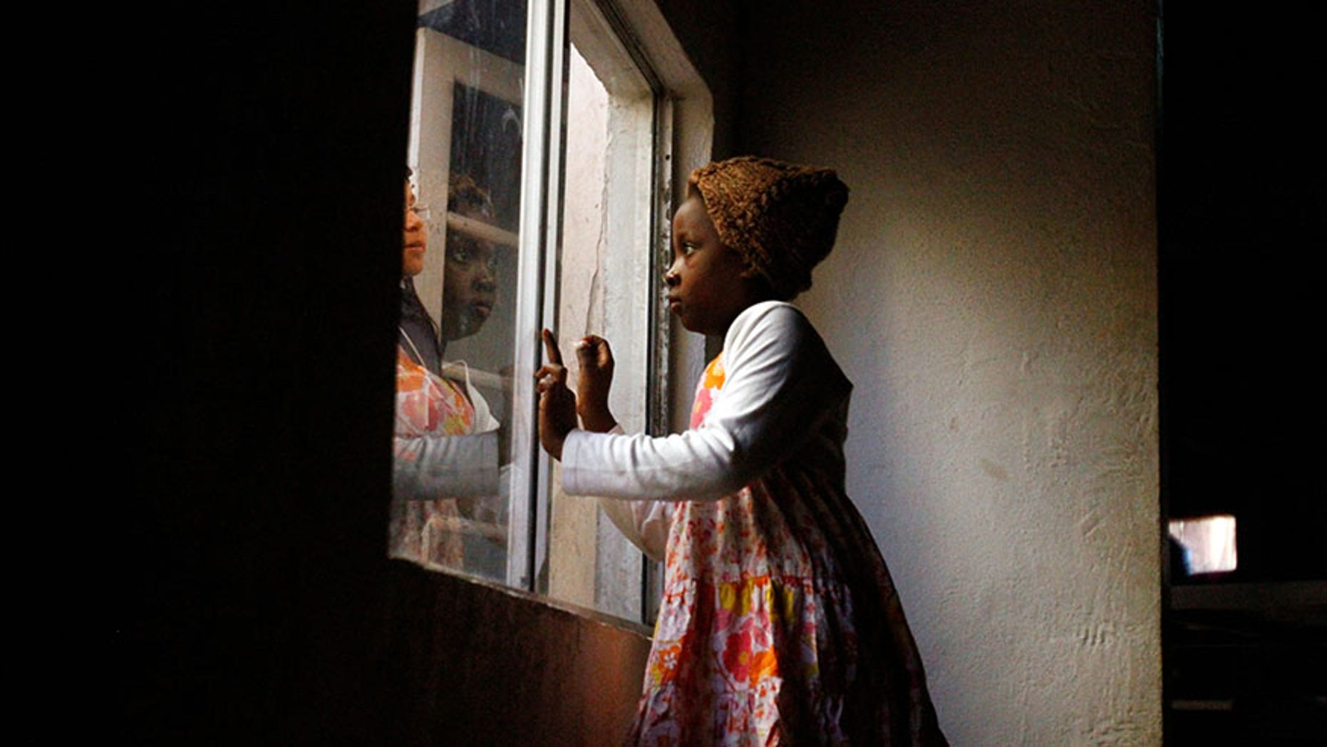 Haitian migrants talk through a window at an Evangelical Church, being used as a shelter for stranded immigrants on their way to the U.S., in Tijuana, Mexico, February 12, 2017.