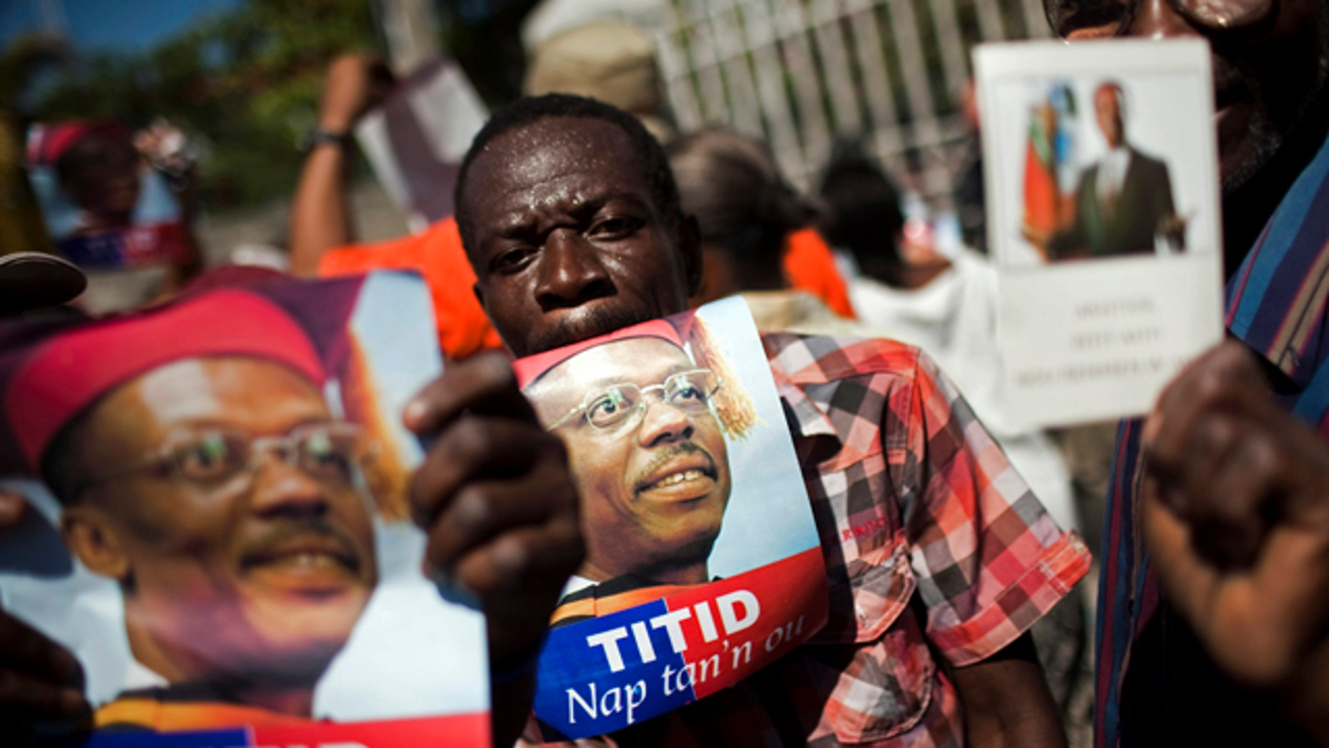 Feb. 2: Demonstrators hold pictures of Haiti's ousted President Jean Bertrand Aristide during a protest demanding his return in Port-au-Prince, Haiti. Aristide is a former priest and liberation theologist who rose to become Haiti's first democratically elected president. He was overthrown in a coup, restored to power, then ousted again in 2004. (AP)