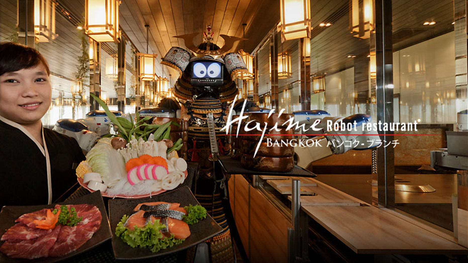 Hajime Robot Restaurant in Bangkok employs robots as their waitstaff. Diners sit facing a glass enclosure where the robots move back and forth on a track and serve customers through windows.