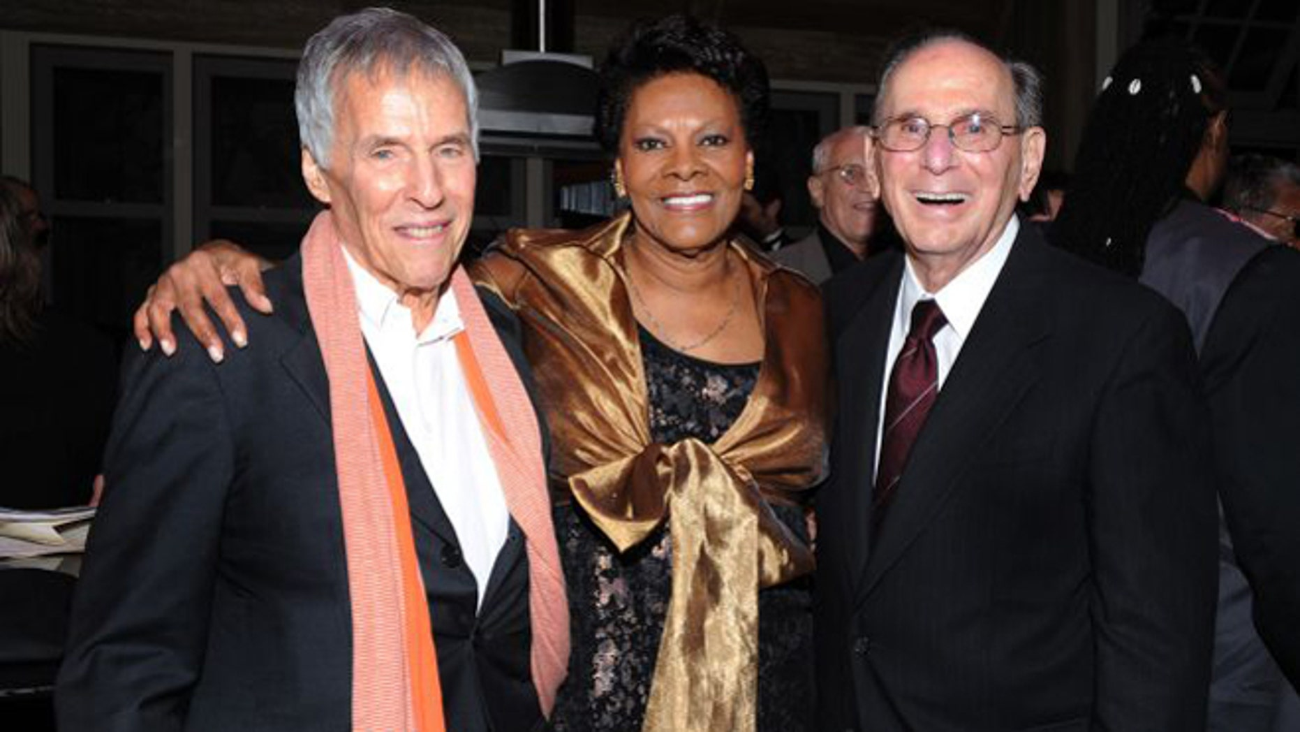 "Oct. 17, 2011: Legendary songwriters Bert Bacharach, left, and Hal David pose with singer Dionne Warwick at the ""Love, Sweet Love"" musical tribute to Hal David on his 90th birthday in Los Angeles, Calif."