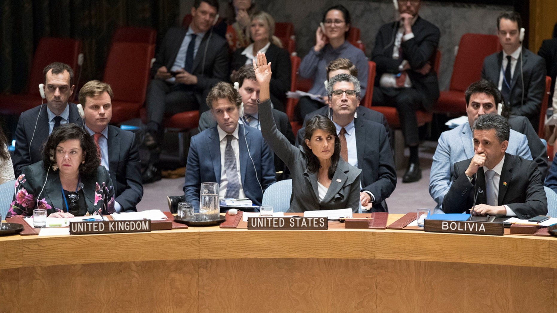 U.S. Ambassador to the United Nations Nikki Haley, center, votes in favor of a resolution introduced by the United States during a Security Council meeting on the situation between the Israelis and the Palestinians, Friday, June 1, 2018 at United Nations headquarters.