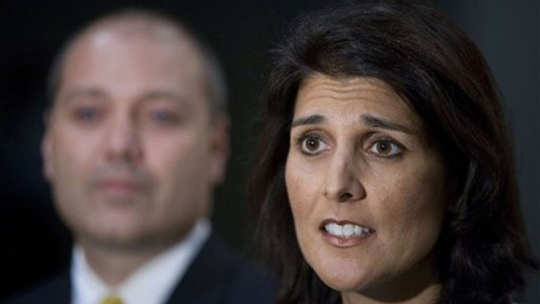 South Carolina state Rep. Nikki Haley talks about allegations of an affair in Greenville, S.C., May 24. She is joined by her husband Michael. (AP Photo)