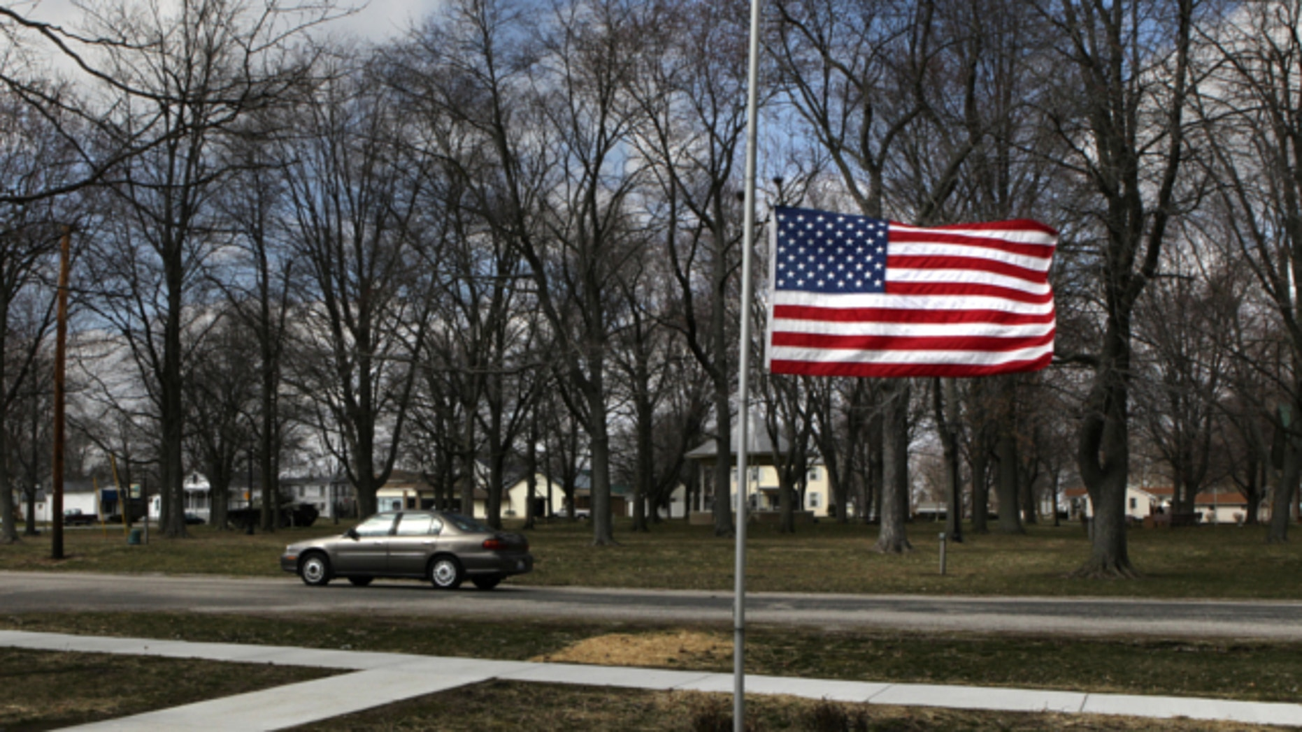 March 20, 2013: Marine Aaron Ripperda of Highland, Ill. is remembered with flags at half mast in nearby downtown Marine, Ill., where his father lives.