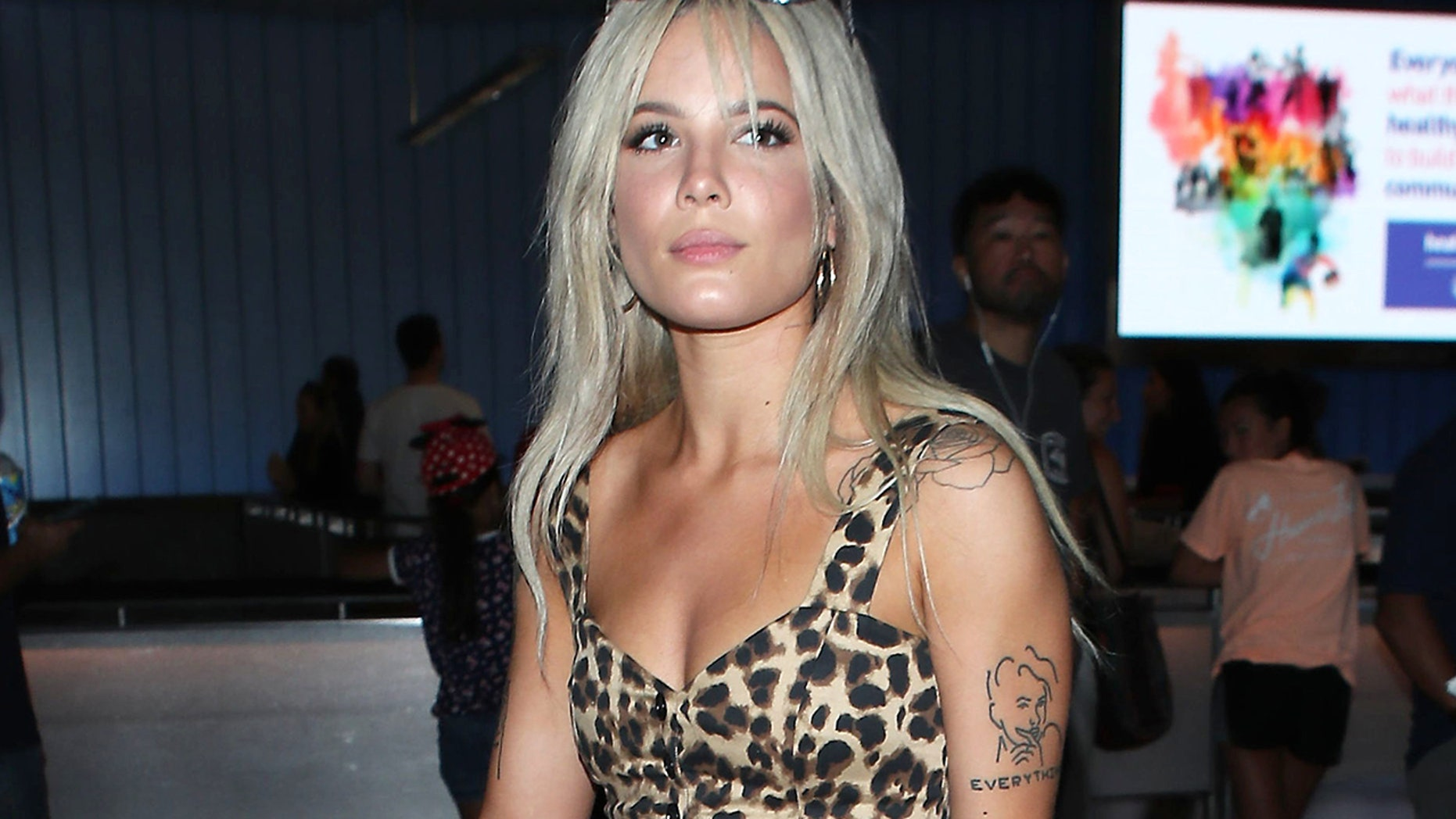 """Halsey arrives in Los Angeles after performing in Santiago, Chile in June 2018. The """"Eyes Open"""" singer puts her perfect, tan body on display in a tiny leopard-print top, paired with cheeky denim cutoffs and black cowboy boots."""