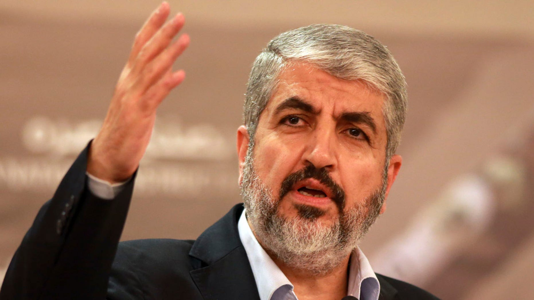 In this Aug. 28, 2014, file photo, Khaled Mashaal leader of the Palestinian Islamic militant movement Hamas, that has governed Gaza since a 2007 takeover, speaks during a speech held in Katara in Doha, Qatar.