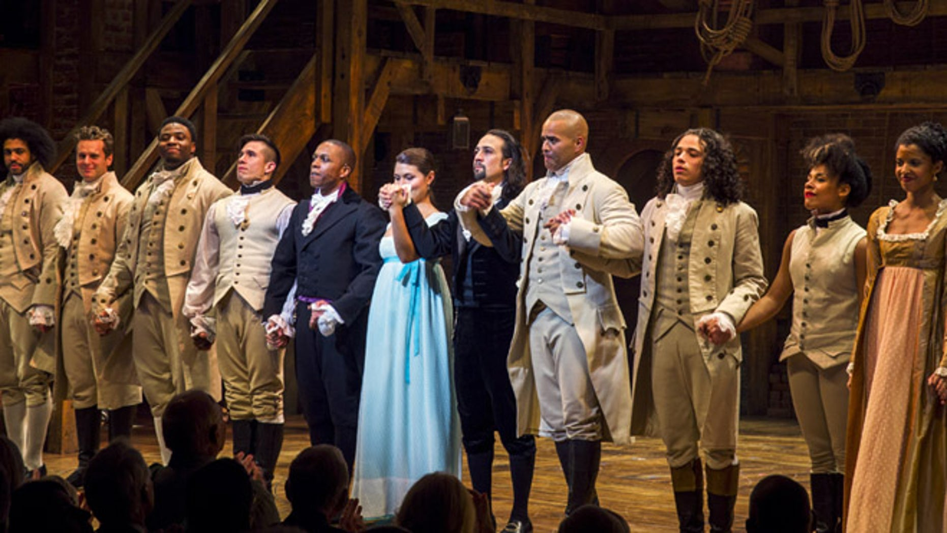 August 6, 2015: Lin-Manuel Miranda (5th right), actor and creator of the of the play 'Hamilton' bows to the audience after opening night of the play on Broadway in New York.