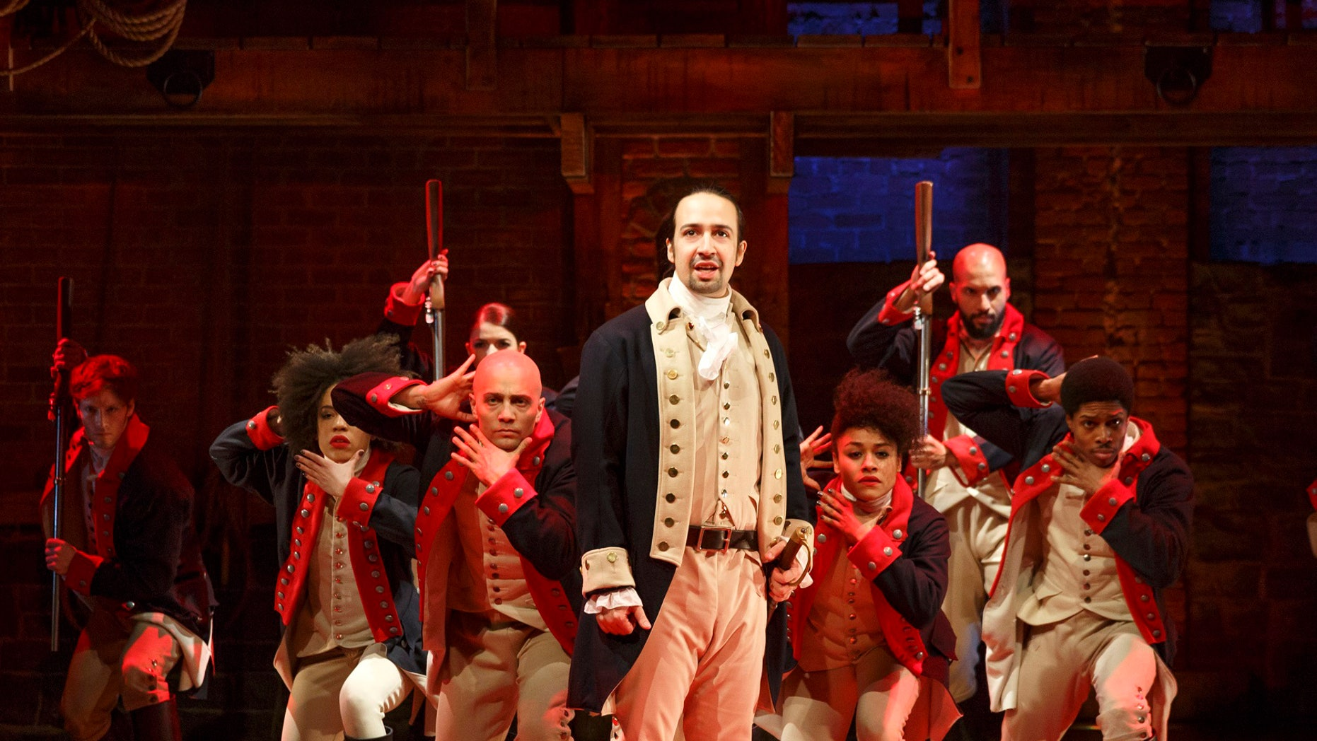 """This image released by The Public Theater shows Lin-Manuel Miranda, foreground, with the cast during a performance of """"Hamilton,"""" in New York. """"Hamilton,"""" the hip-hop stage biography of Alexander Hamilton won the 2016 Pulitzer Prize for drama on Monday, April 18, 2016. (Joan Marcus/The Public Theater via AP)"""