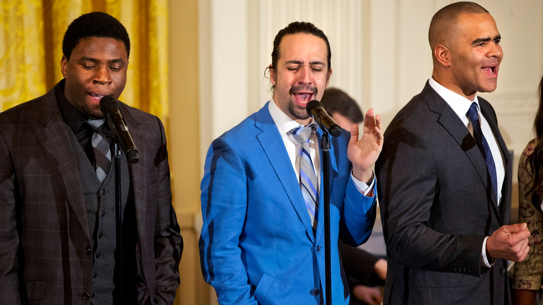 """Actor Okieriete Onaodowan, left, actor Lin-Manuel Miranda, and actor Christopher Jackson perform the song """"Alexander Hamilton"""" from the Broadway play """"Hamilton"""" in the East Room of the White House, in Washington, Monday, March 14, 2016. (AP Photo/Jacquelyn Martin)"""