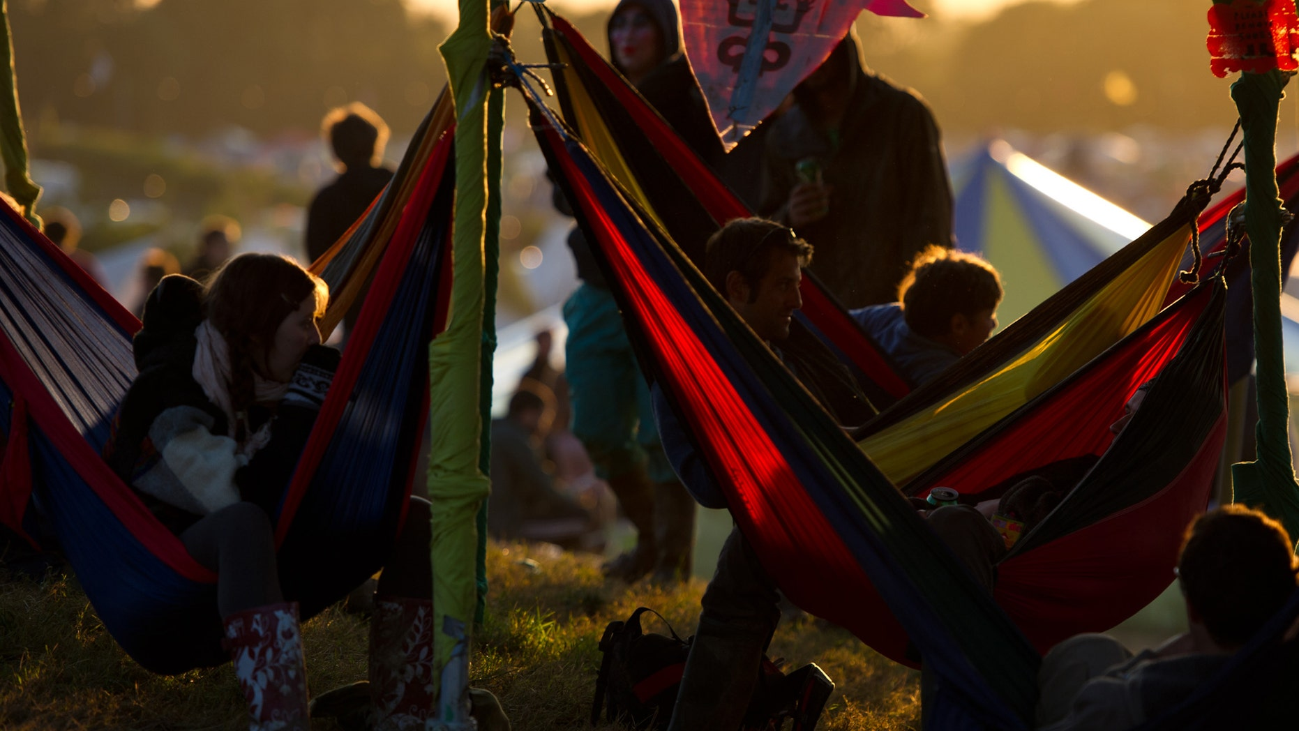 GLASTONBURY, ENGLAND - JUNE 23:  Festival goers relax in hammocks during the Glastonbury Festival at Worthy Farm, Pilton on June 23, 2011 in Glastonbury, England. The festival, which started in 1970 when several hundred hippies paid 1 GBP to watch Marc Bolan, has grown into Europe's largest music festival attracting more than 175,000 people over five days  (Photo by Ian Gavan/Getty Images)