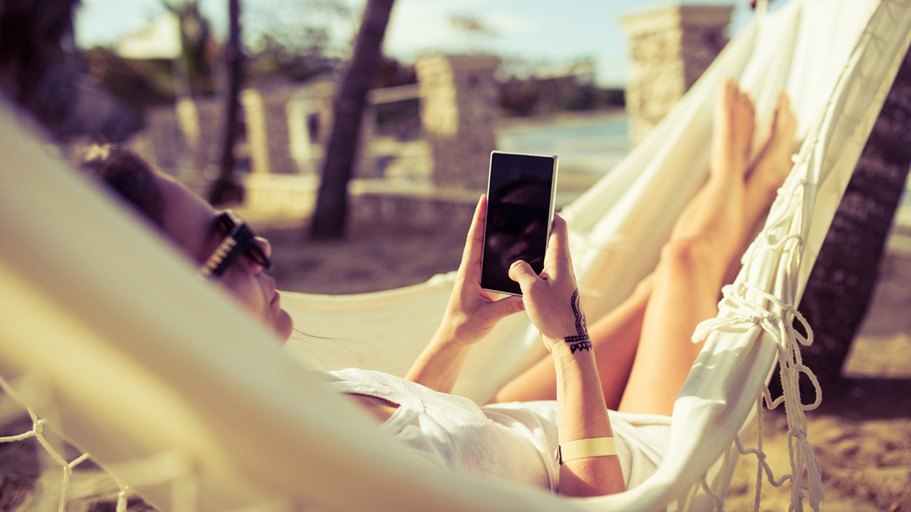 Study participants checked their phone an average of every 12 minutes while on vacation — even when there were hammocks involved!
