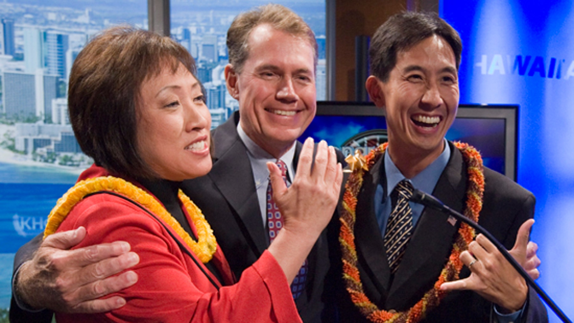 In this Friday, May 14, 2010 picture, Hawaii State Senate President Colleen Hanabusa, left, former U.S. Rep. Ed Case, center, both Democrats and Republican Honolulu City Councilman Charles Djou, right, embrace each other after patricipating in a debate at the KHON2 television studios in Honolulu. (AP)