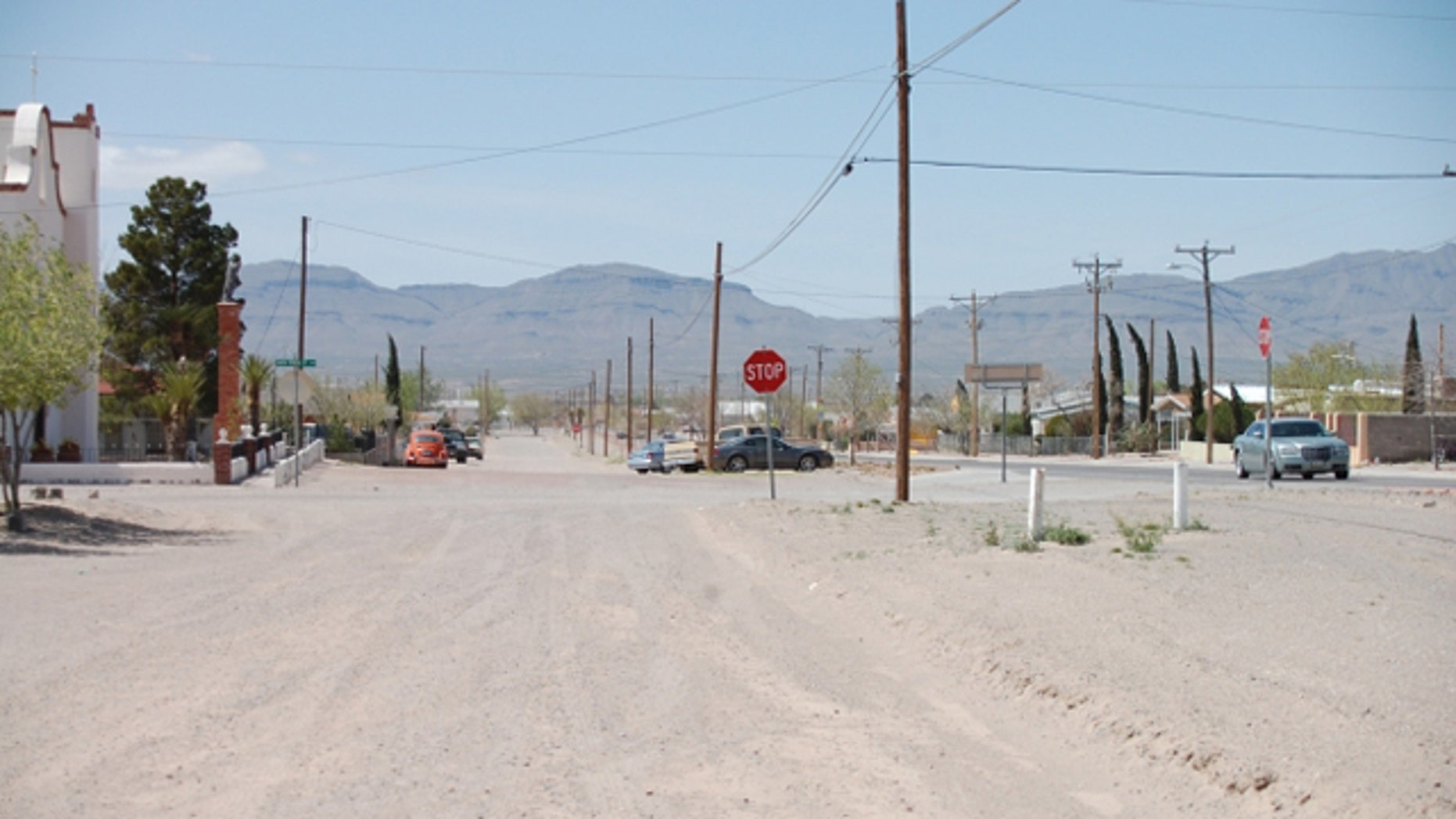 April 2, 2010: A street in Fort Hancock, Texas, roughly 25 miles west of Fort Quitman, where four Hudspeth County employees were working on a remote, unpaved road when an unknown gunman fired from across the Rio Grande at about 10:30 a.m. Thursday. Mexico can be seen in the background. (FoxNews.com/Joshua Rhett Miller)