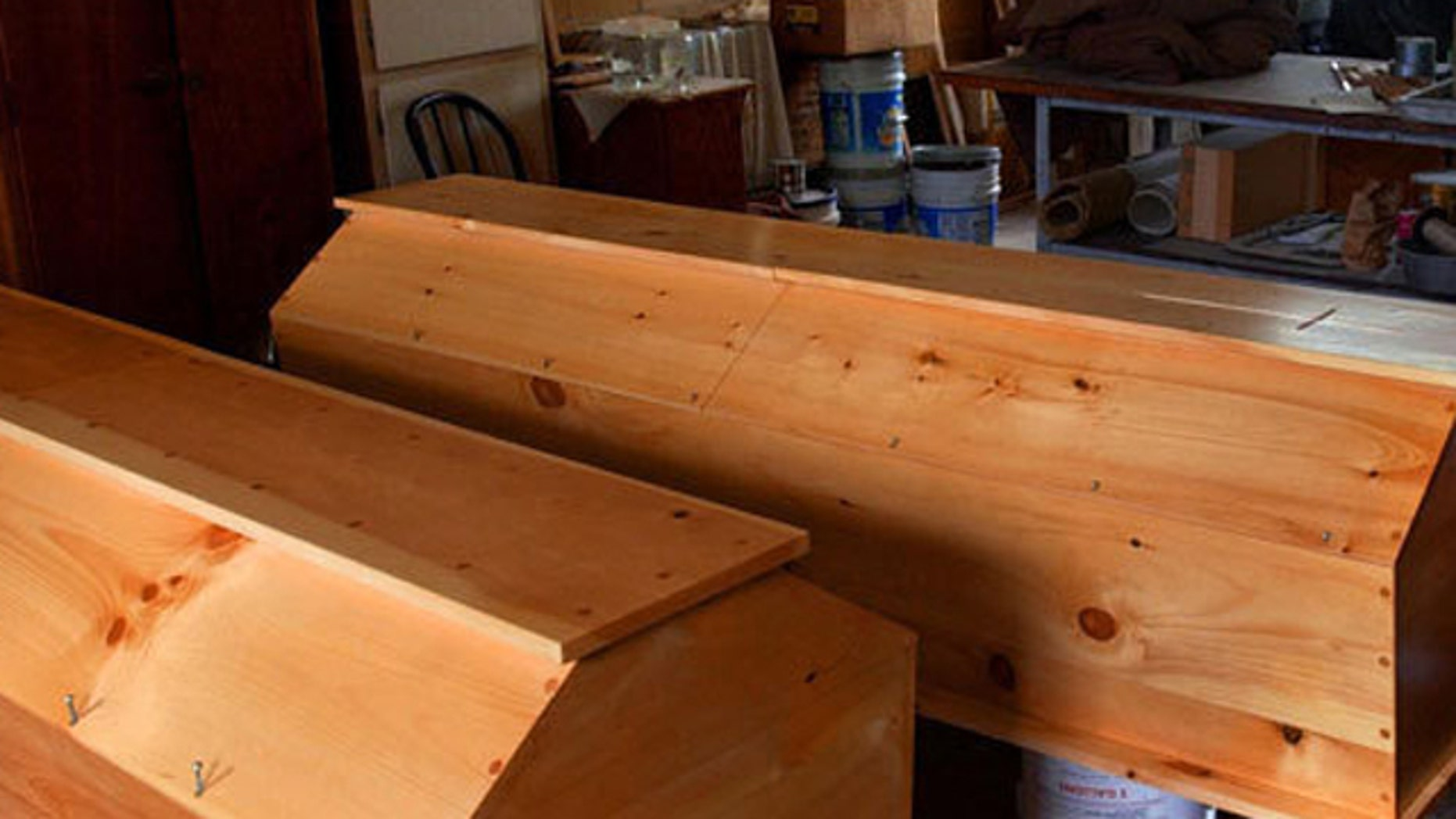 The monks make handcrafted caskets like these pictured.