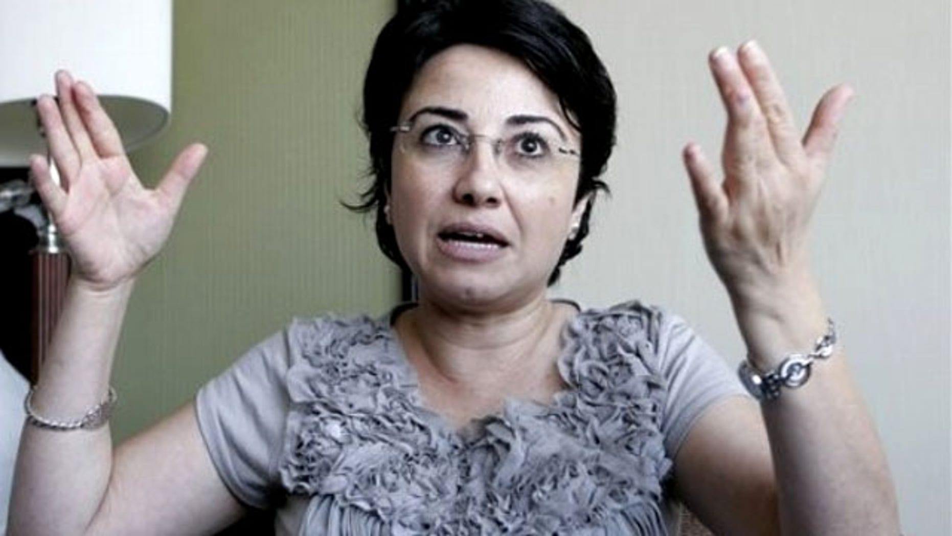 Israeli-Arab Knesset member Hanin Zoabi gestures as she talks to the media in Amman, Jordan, Tuesday, Aug. 31, 2010, after being interviewed by investigators from a U.N. human rights inquiry on the May 31 flotilla attack.