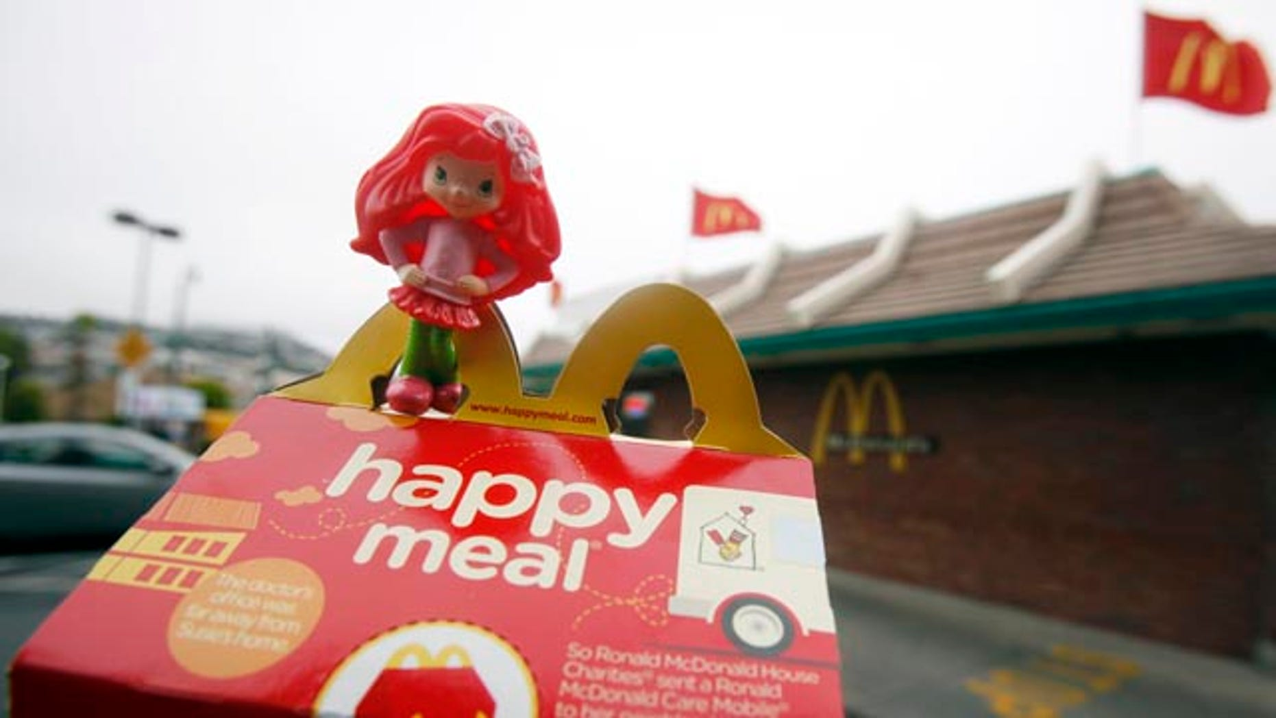 A Happy Meal box and toy are shown outside of a McDonald's restaurant in San Francisco. San Francisco has become the first major American city to prohibit fast-food restaurants from including toys with children's meals that do not meet nutritional guidelines.