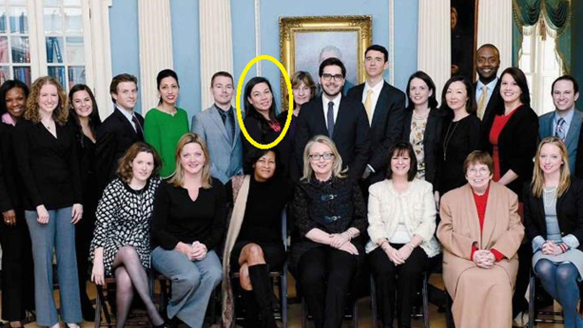 "Monica Hanley, pictured standing in the back row right behind Hillary Clinton aide Cheryl Mills in a State Department photo from Clinton's book ""Hard Choices."""