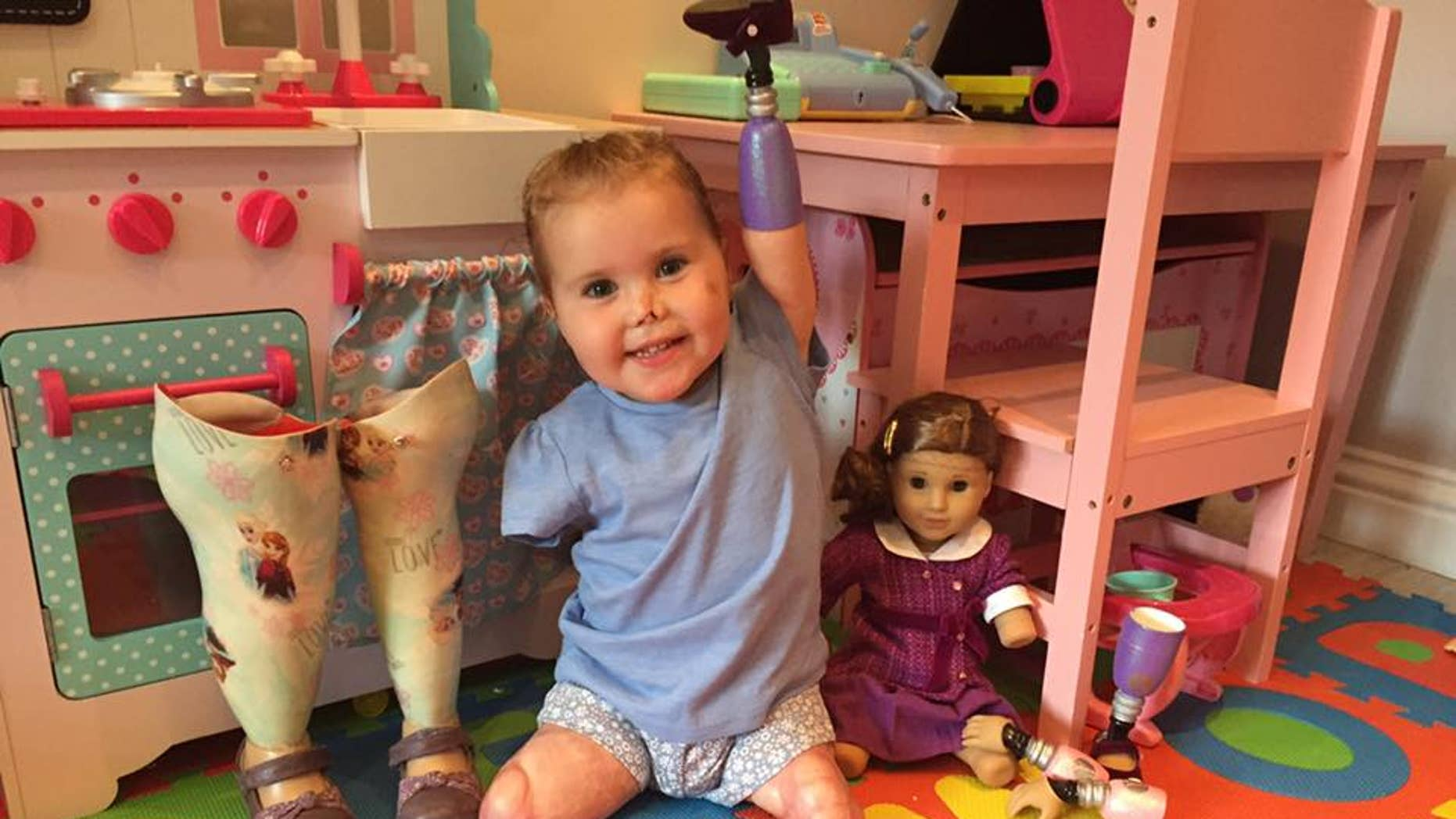 Harmonie poses with her new doll.