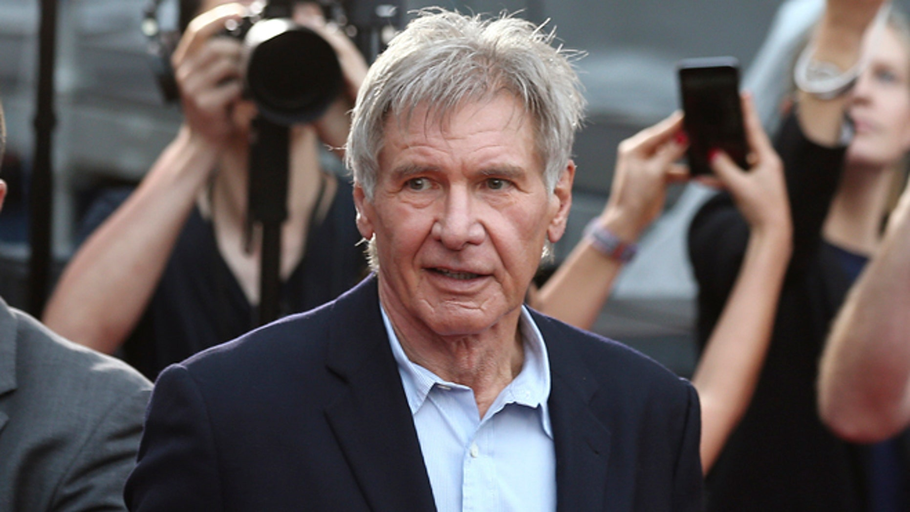 Harrison Ford told an air traffic controller that he was distracted when he flew over a plane.