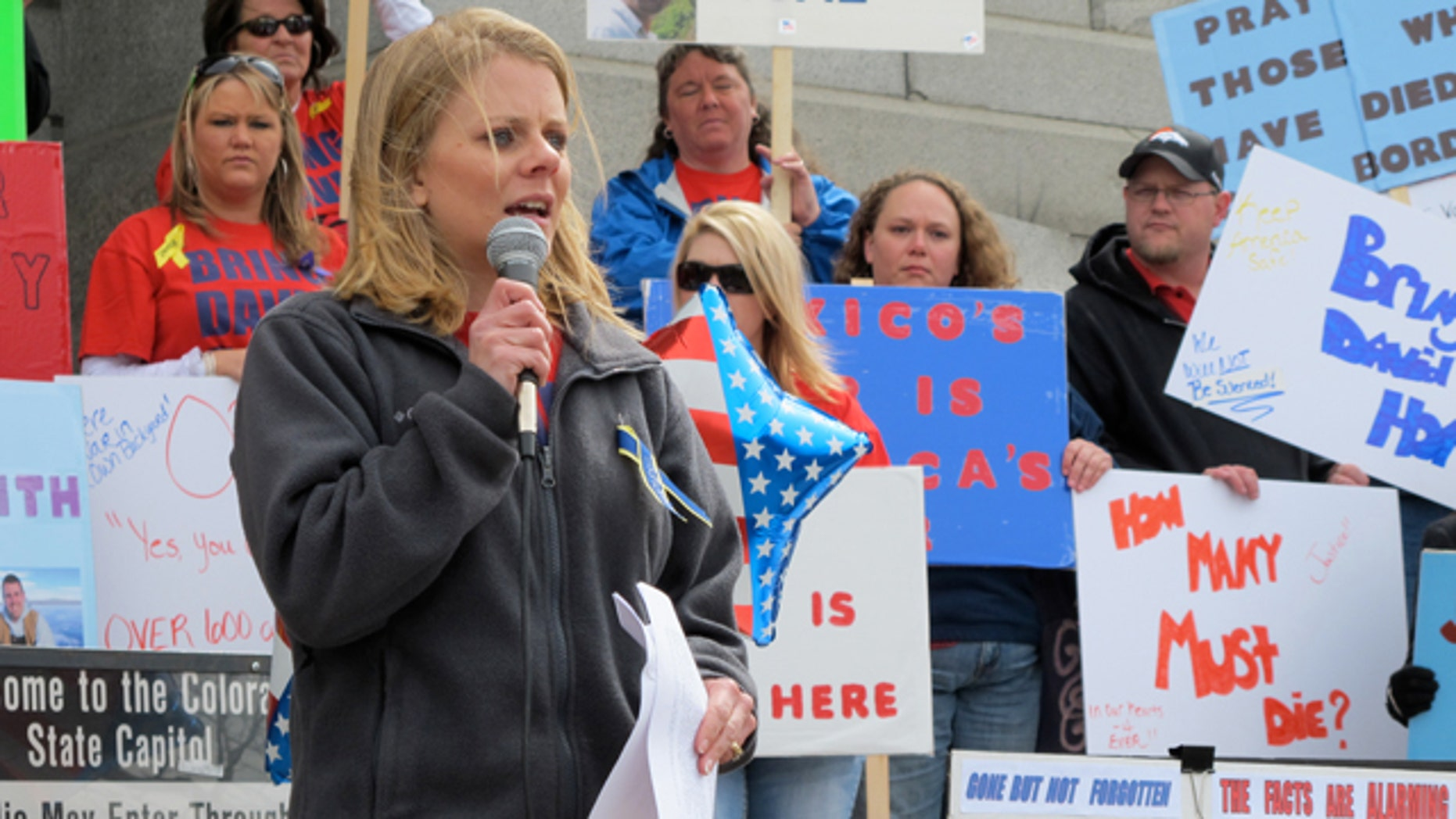Tiffany Hartley speaks to a rally on the steps of the Colorado State Capitol in Denver.