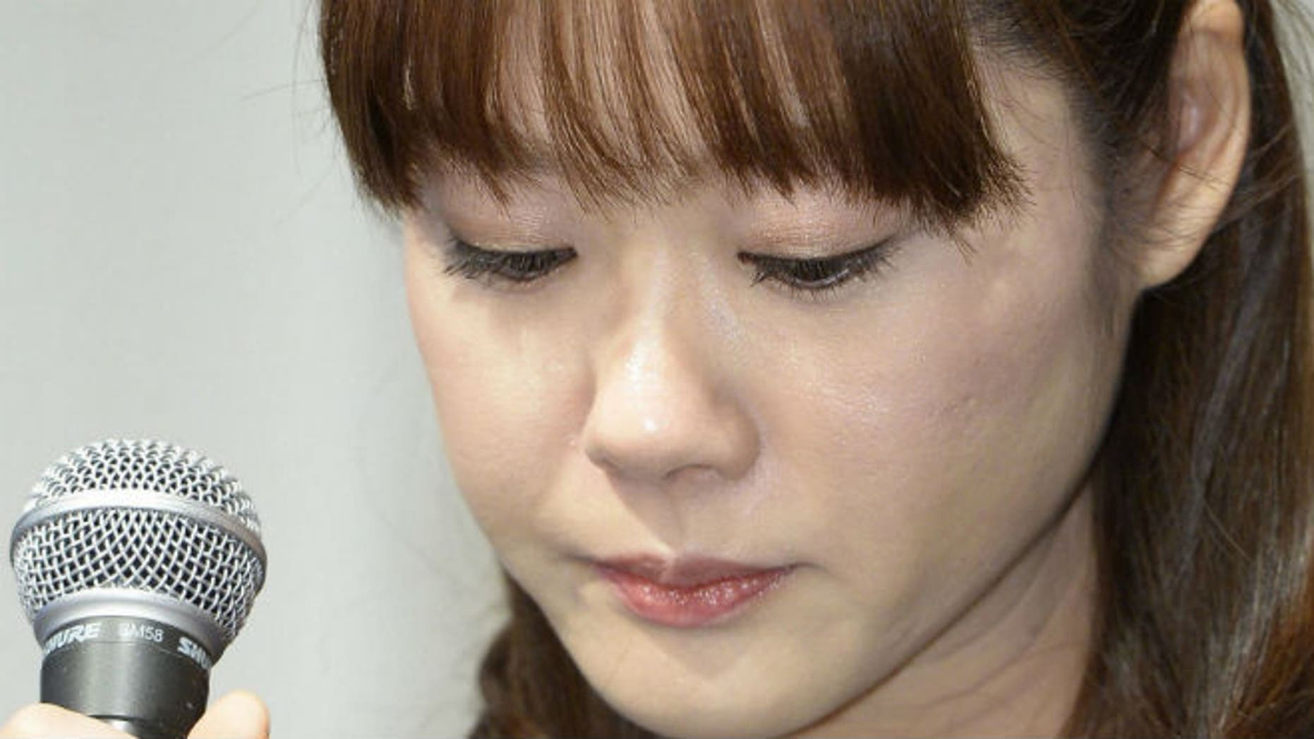 Haruko Obokata, a researcher at semi-governmental research institute RIKEN, lowers her eyes during a news conference in Osaka, western Japan, in this photo taken by Kyodo April 9, 2014. REUTERS/Kyodo