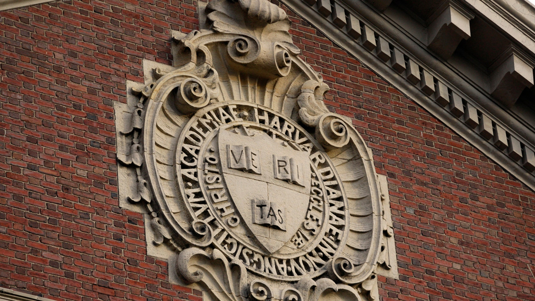 The university seal hangs over a building at Harvard University in Cambridge, Massachusetts, Nov. 16, 2012.