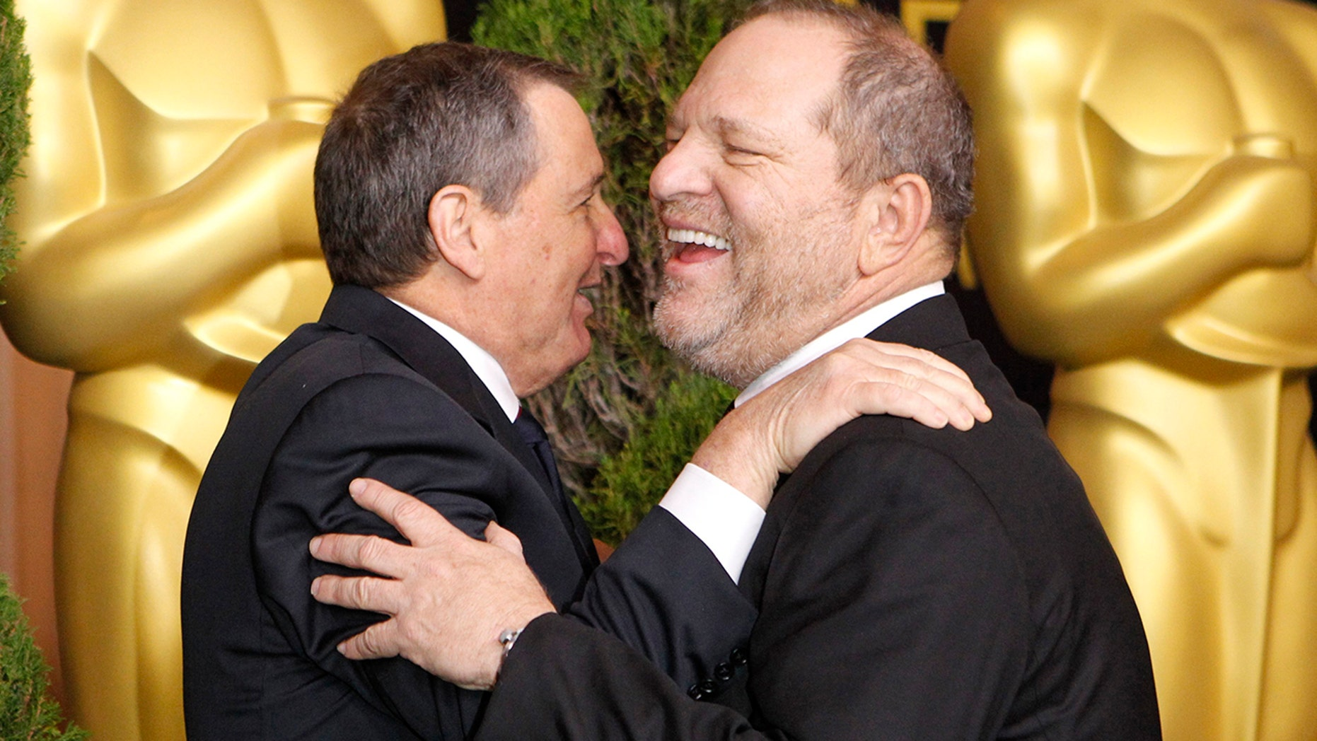 Tom Sherak (L), president of the Academy of Motion Picture Arts and Sciences, greets Harvey Weinstein, co-founder of The Weinstein Company as he arrives at the 84th Academy Awards nominees luncheon in Beverly Hills, California February 6, 2012.   REUTERS/Mario Anzuoni  (UNITED STATES-Tags: - Tags: ENTERTAINMENT BUSINESS) - GM1E8270LHN01