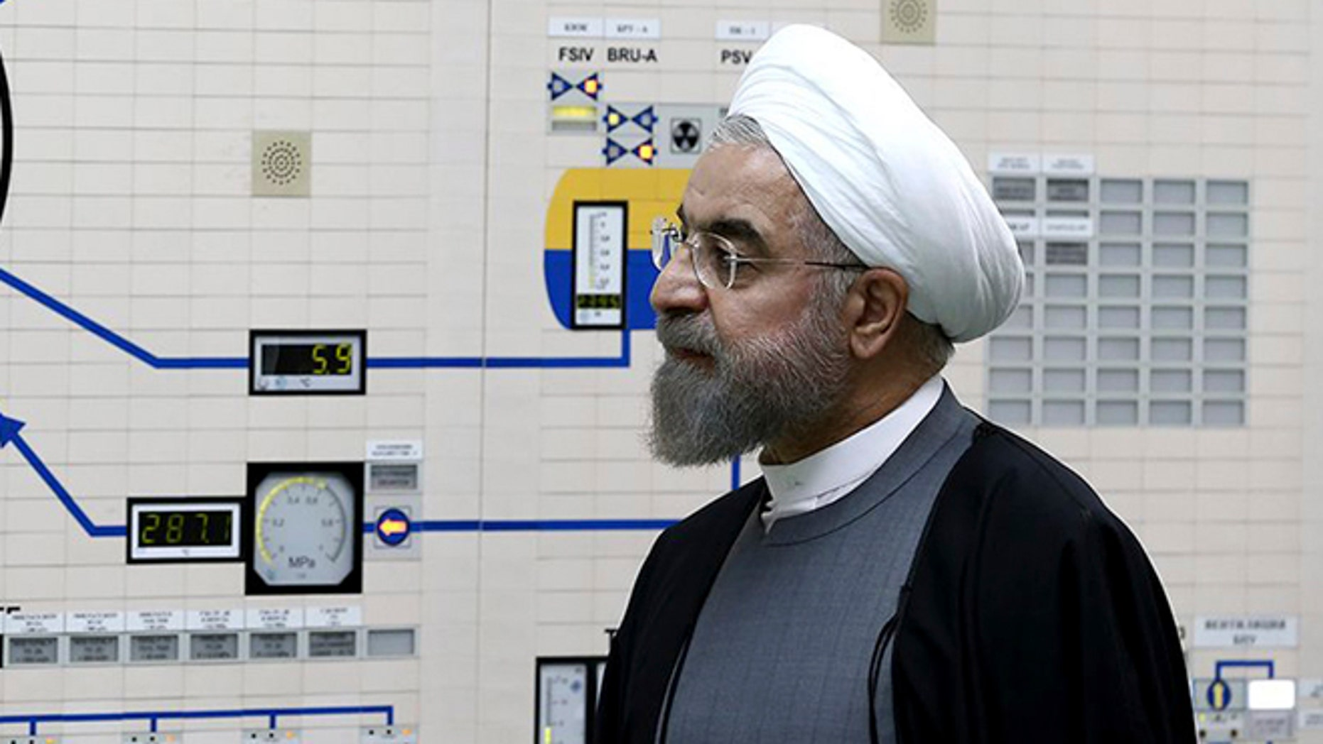 In this photo released by the Iranian Presidency Office, President Hassan Rouhani visits the Bushehr nuclear power plant just outside the port city of Bushehr, southern Iran, Tuesday, Jan. 13, 2015.