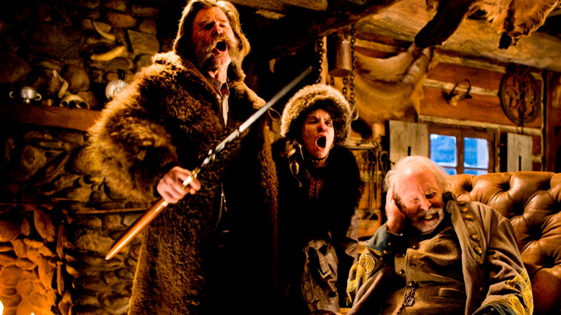 """This image released by The Weinstein Company shows Kurt Russell, from left, Jennifer Jason Leigh and Bruce Dern in a scene from the film, """"The Hateful Eight."""""""
