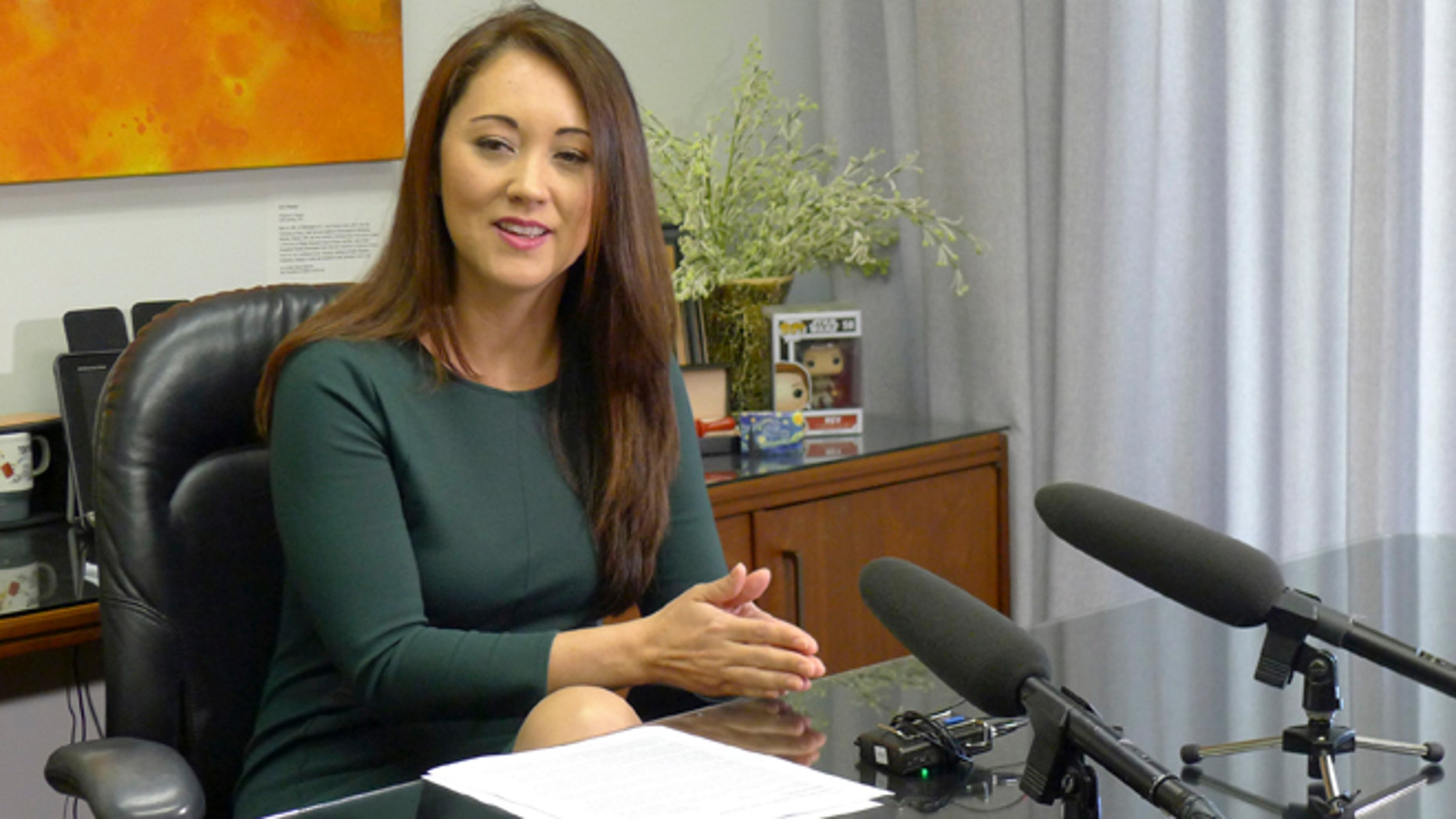 March 22, 2017: Hawaii Rep. Beth Fukumoto talks to reporters about why she's leaving the Republican Party in Honolulu.
