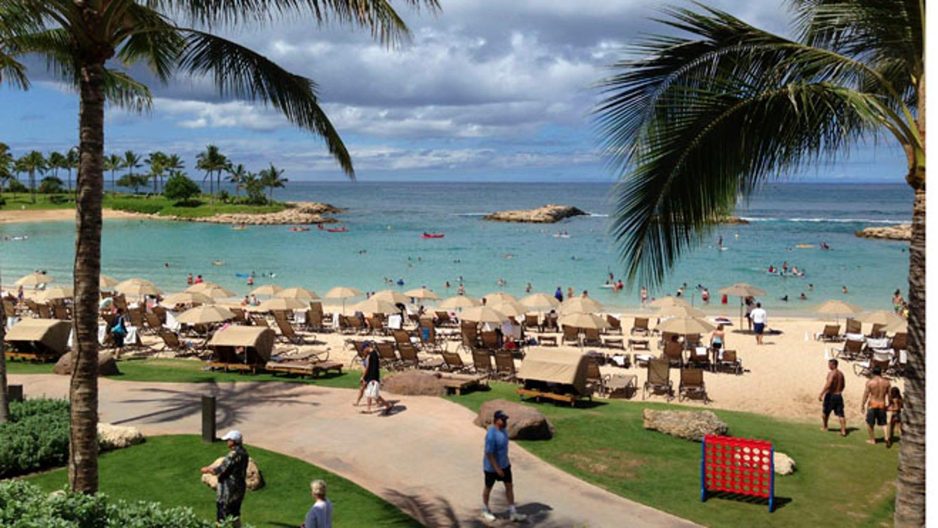 July 29, 2013: Tourists and locals play on Ko'Olina beach on the island of Oahu, Hawaii.