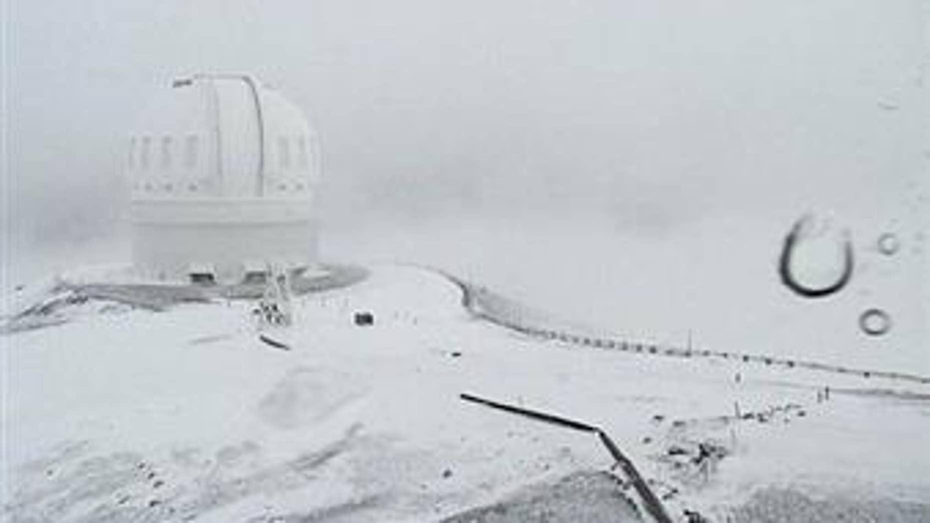 This webcam image shows the CFHT telescope on the summit of Mauna Kea on Hawaii's Big Island covered in snow on Dec. 1, 2016.