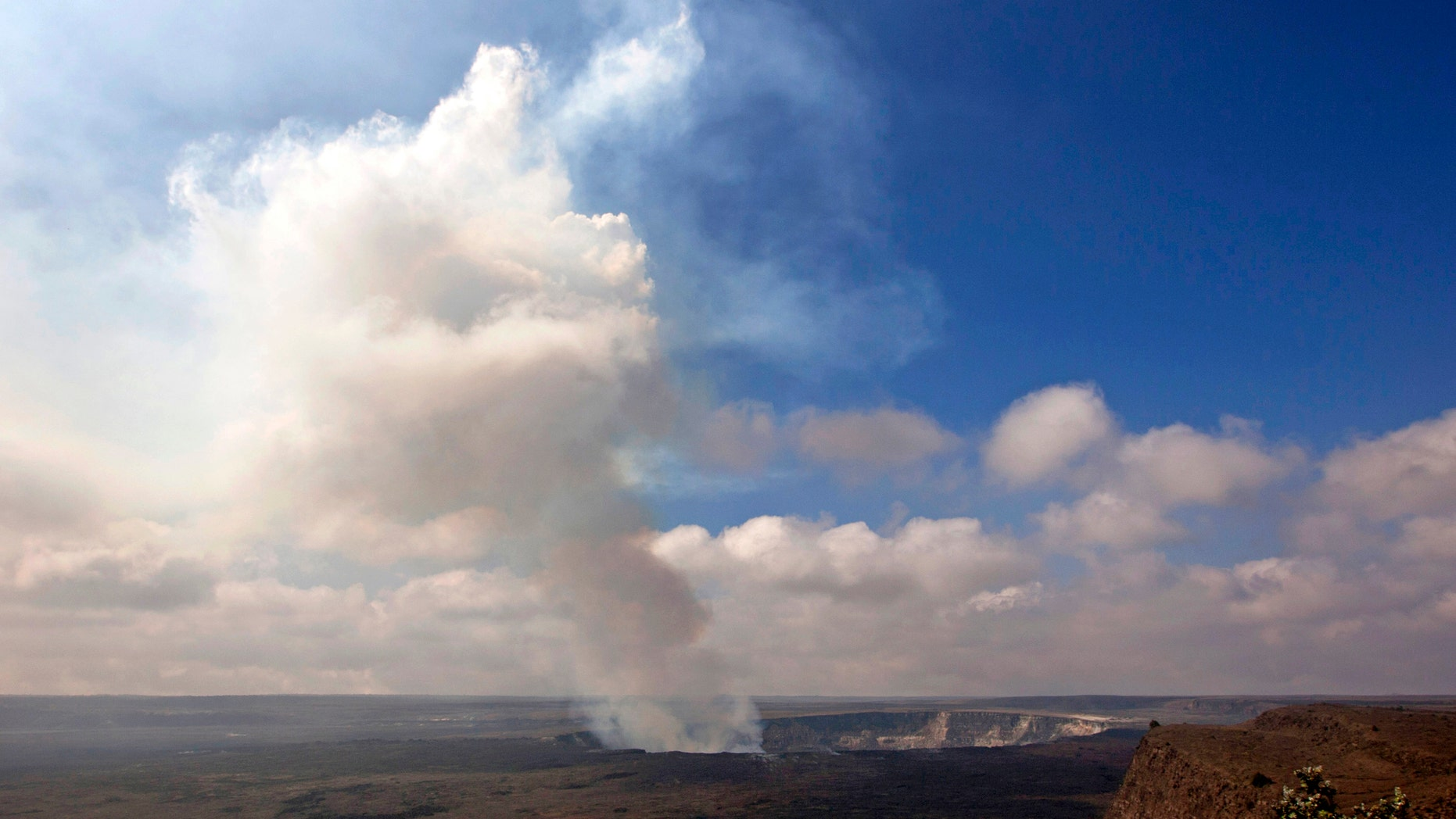 Sept. 1, 2015 photo of volcanic gas rising from the lava lake in Kilauea's Halemaumau Crater (AP Photo/Caleb Jones)