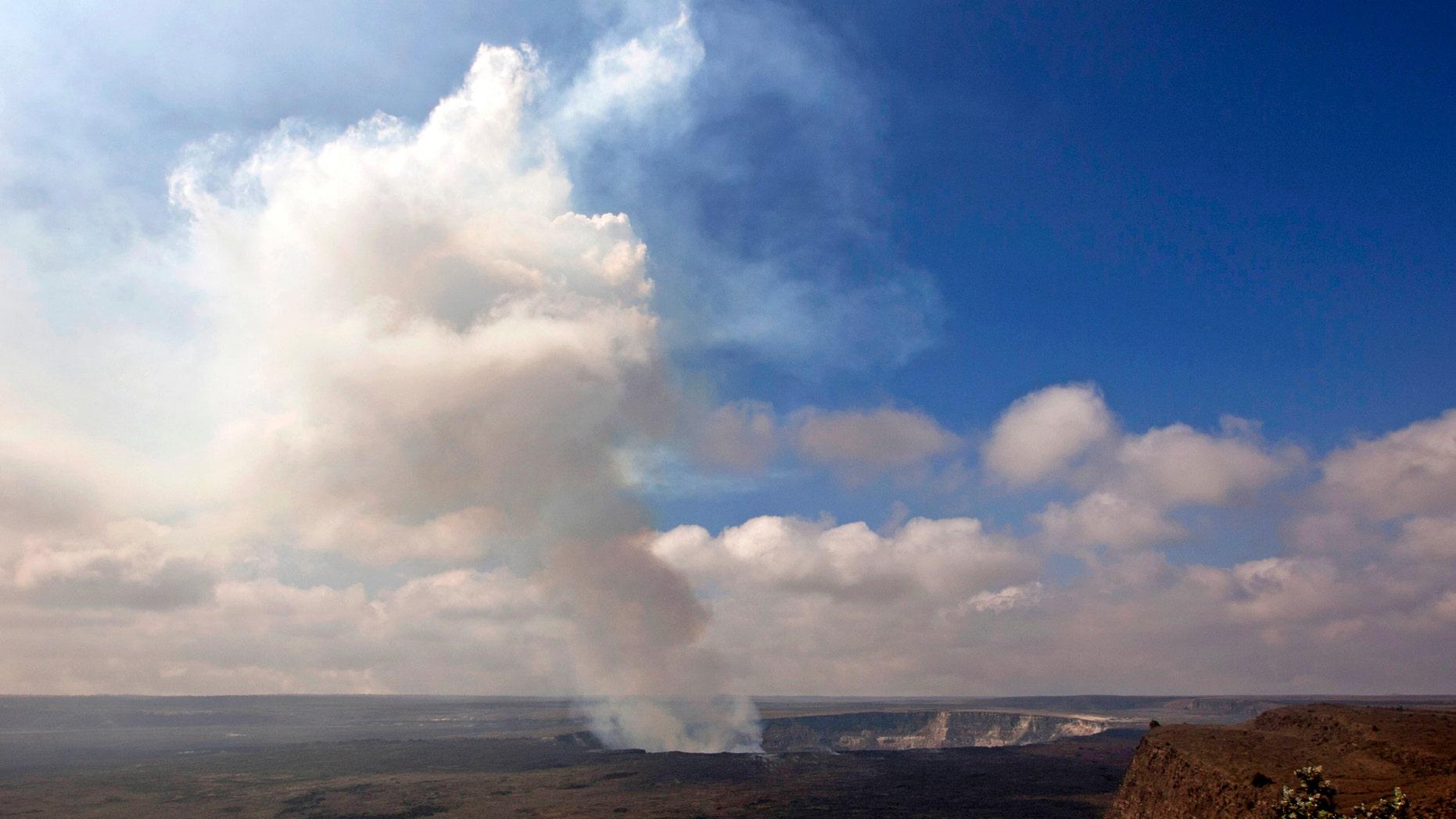 Sept. 1, 2015 photo of volcanic gas rising from the lava lake in Kilauea's Halemaumau Crater (AP Photo/Caleb Jones)