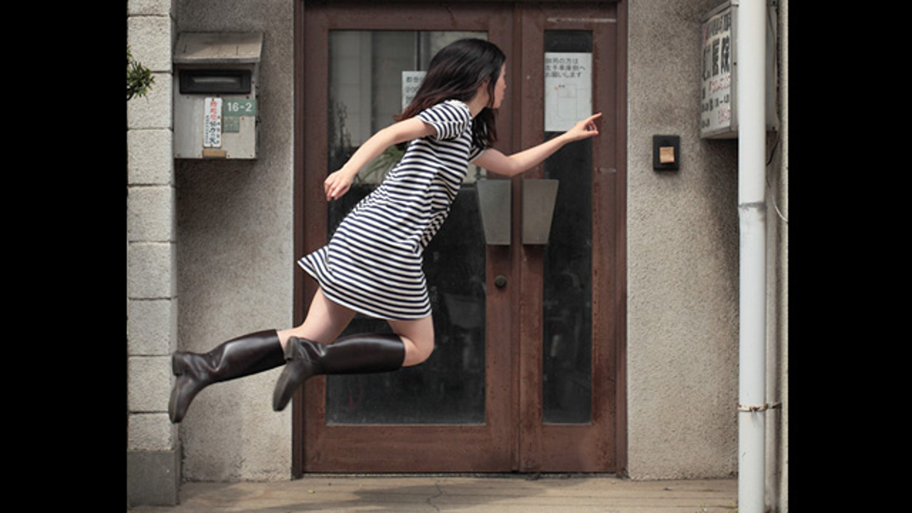 Photographer Natsumi Hayashi captures herself 'levitating' outside an abandoned Tokyo clinic. These peaceful shots sometimes take 300 tries to capture.