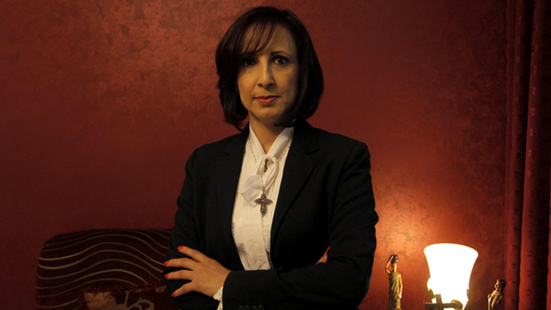 May 26, 2012:  Former assistant manager of corporate operations for Jordan Dubai Islamic Bank Vivian Salameh poses for a portrait in Amman, Jordan.