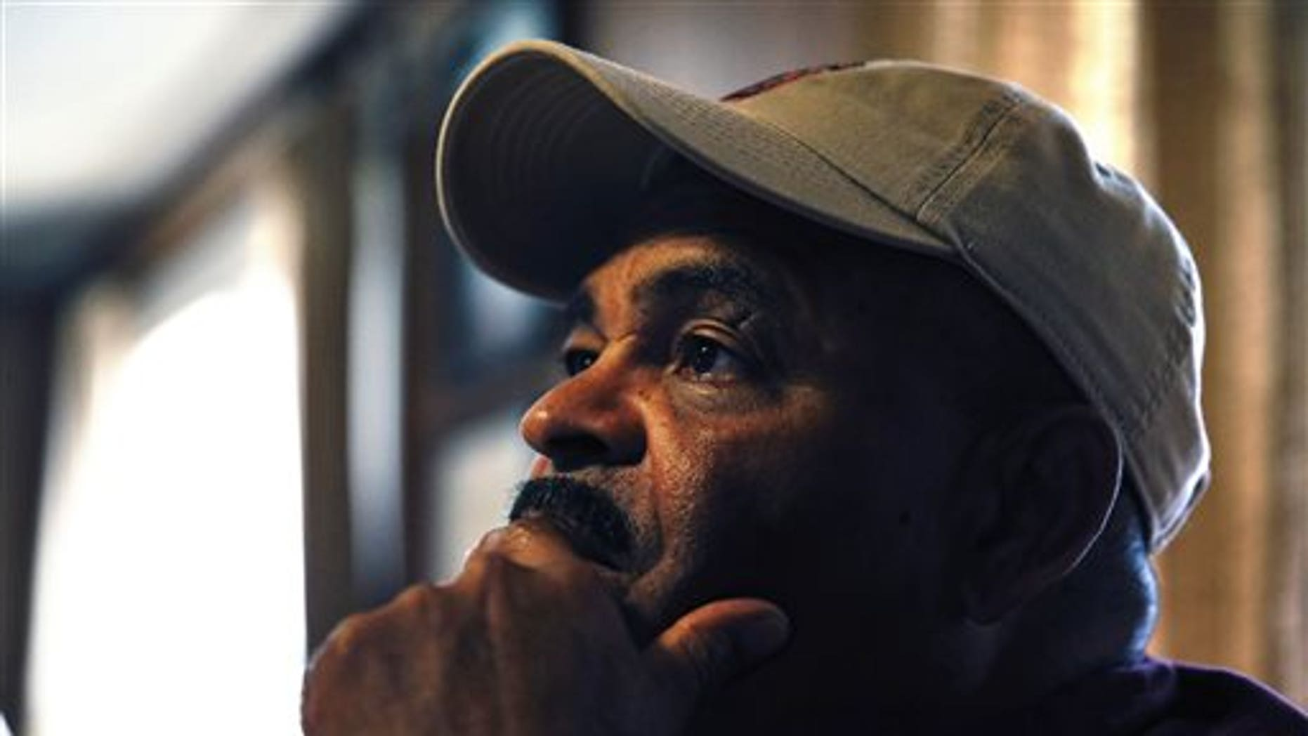 In this March 16, 2015 photo, retired U.S. Army Sgt. 1st Class Marshall Powell sits at the dining room table and pauses while talking about his emotionally traumatic experiences serving as a military nurse in northern Iraq in 2007, during one of the bloodiest years of the conflict, at Powell's home in Crescent, Okla. (AP Photo/Brennan Linsley)