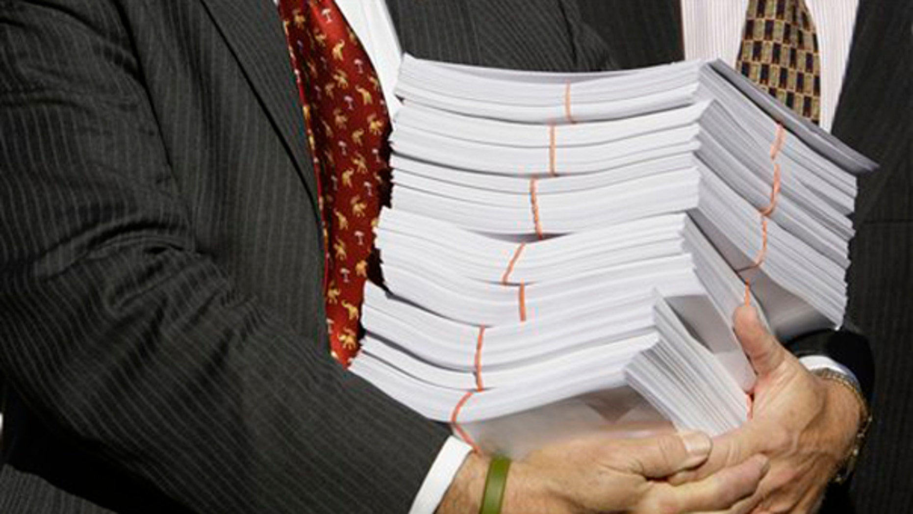 The 1,900-page House health care bill, shown here, is expected to come to the floor for debate in a matter of days. (AP Photo)