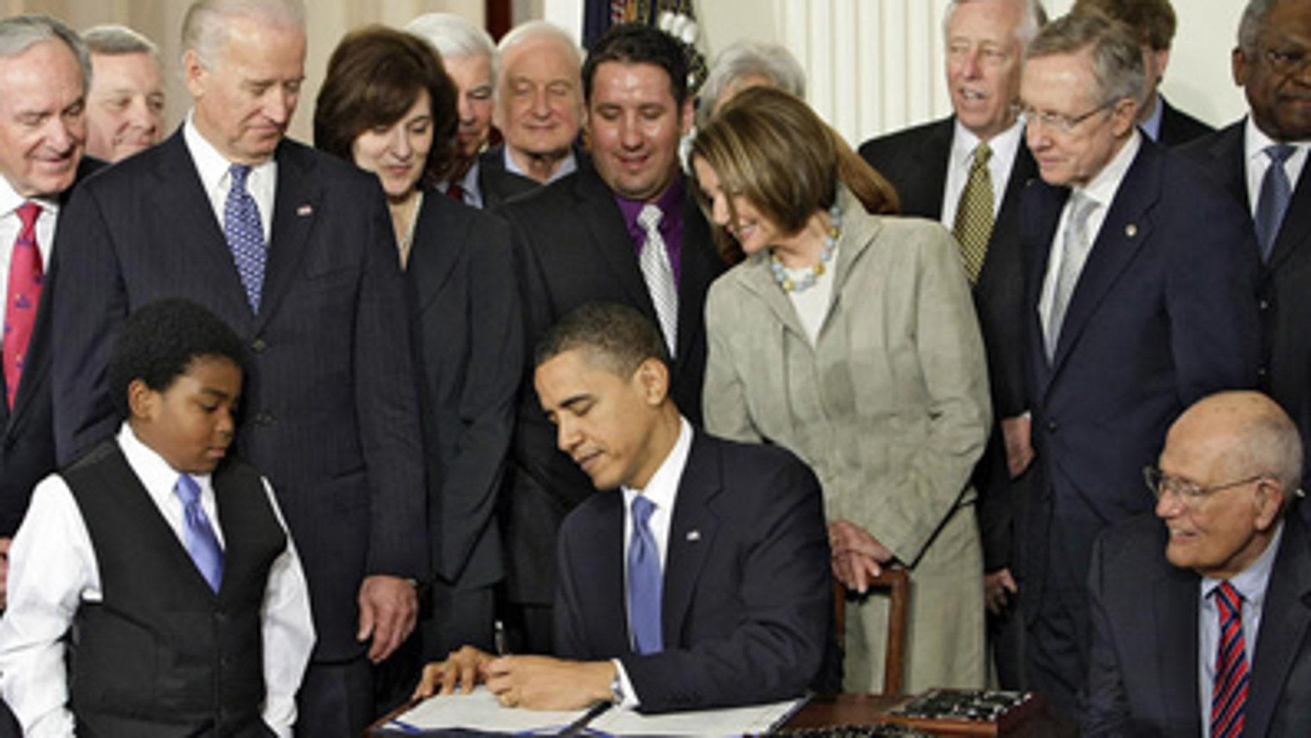 U.S. President Barack Obama singing the Health Care Reform bill in Washington, D.C.