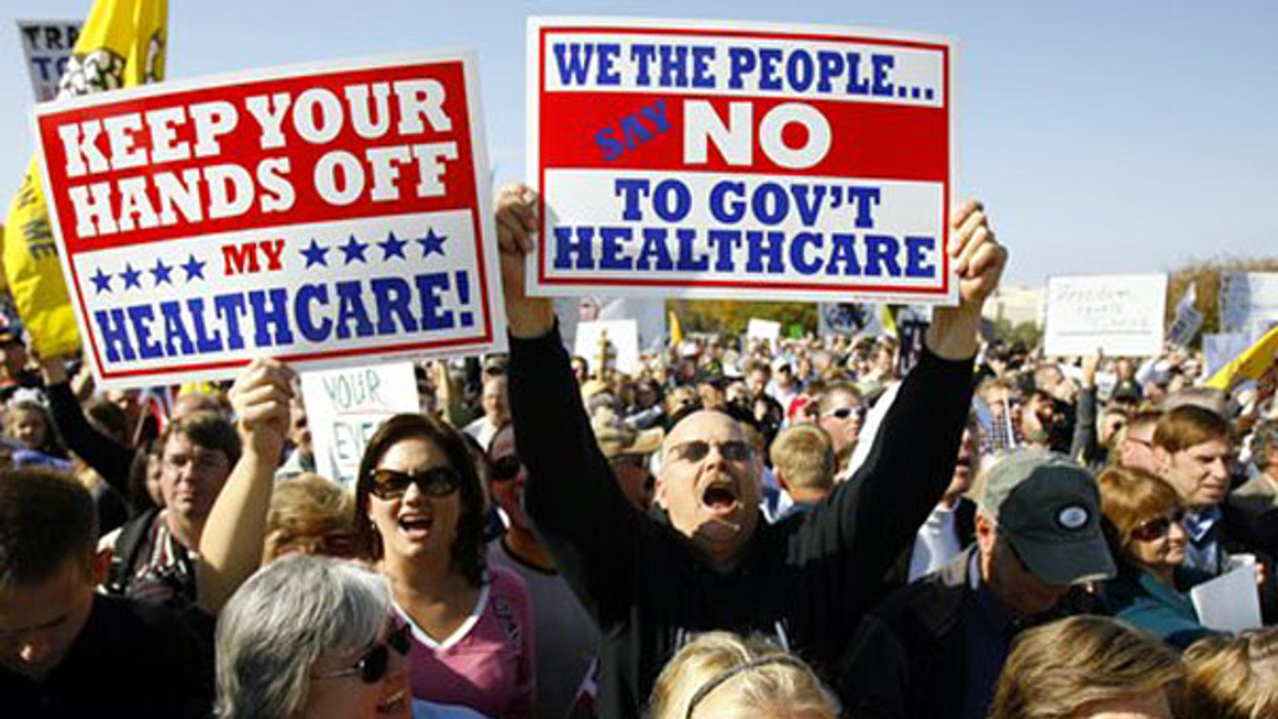 Demonstrators chant on Capitol Hill Nov. 5 during a Republican health care reform rally. (AP Photo)